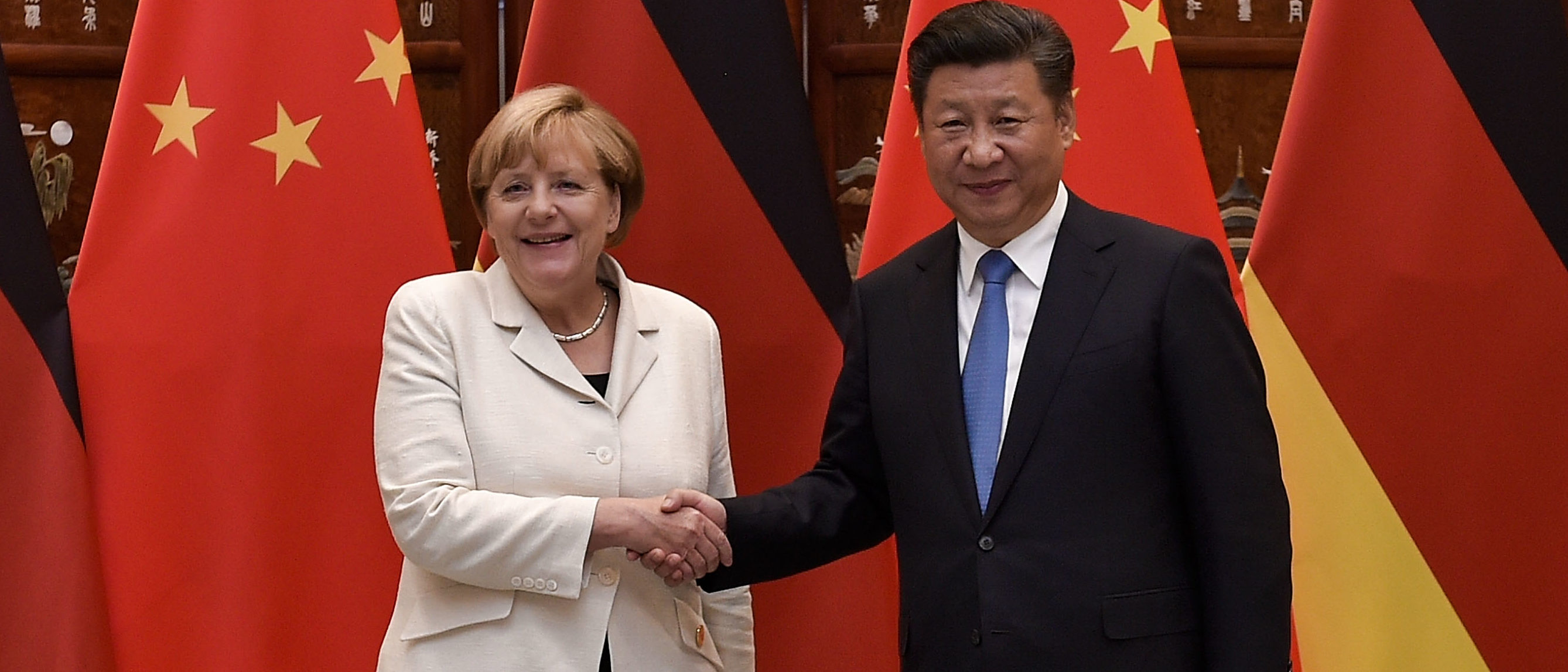 Chinese President Xi Jinping (R) shakes hand with German Chancellor Angela Merkel (L) before their meeting at the West Lake State House on September 5, 2016 in Hangzhou, China. World leaders have gathered in Hangzhou for the 11th G20 Leaders Summit from September 4 to 5. Photo by Etienne Oliveau - Pool/Getty Images)
