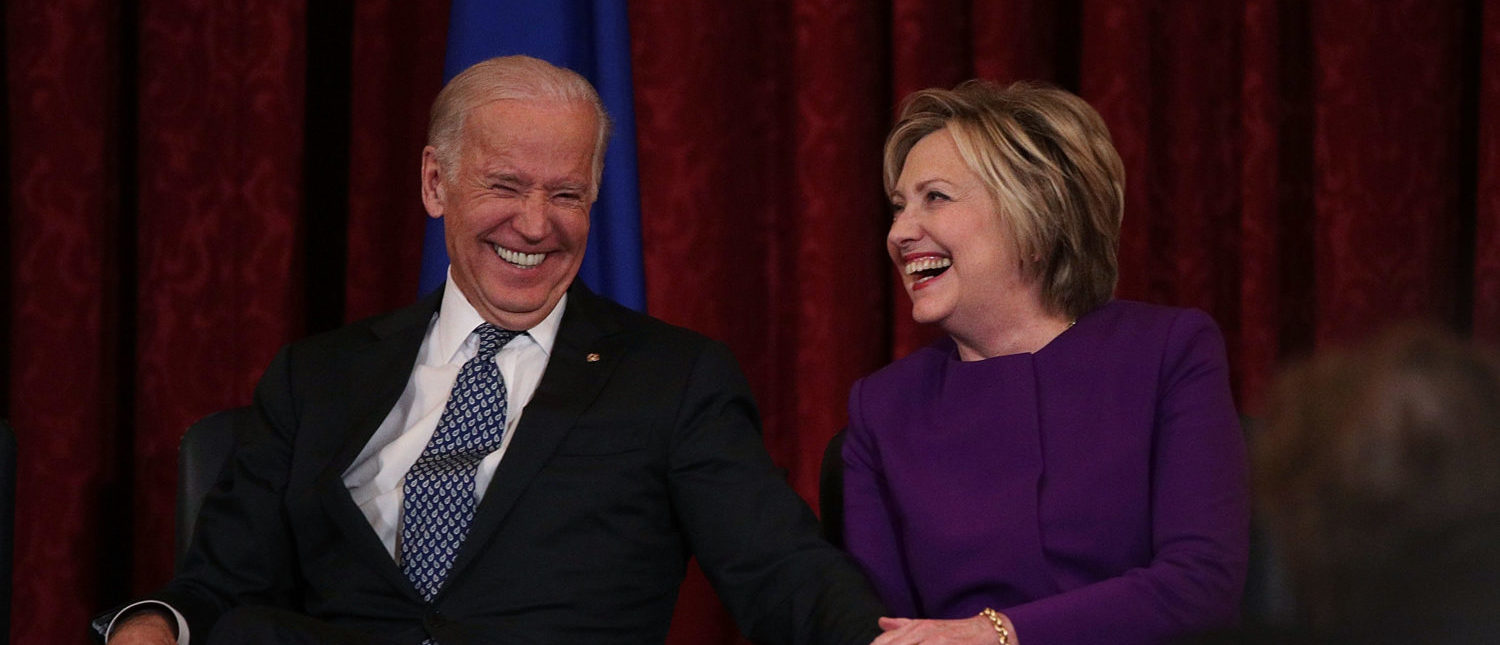 WASHINGTON, DC - DECEMBER 08: Former U.S. Secretary of State Hillary Clinton (R) shares a moment with Vice President Joseph Biden (L) during a leadership portrait unveiling ceremony for Senate Minority Leader Sen. Harry Reid (D-NV) December 8, 2016 on Capitol Hill in Washington, DC. The leadership portrait unveiling ceremony was held to honor the outgoing Democratic leader. (Photo by Alex Wong/Getty Images)