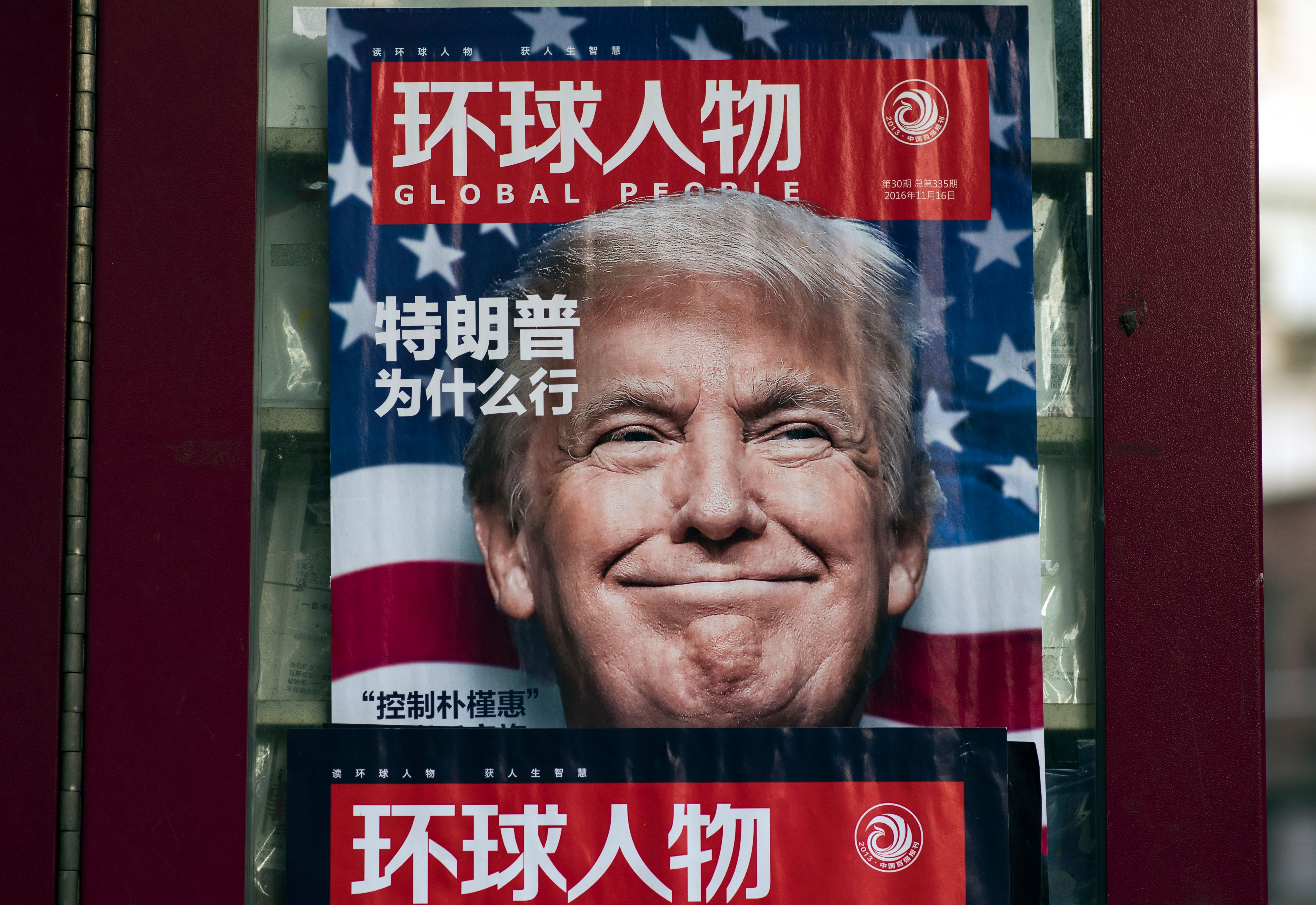"This picture taken on December 14, 2016 shows a advertisement for a magazine featuring US President-elect Donald Trump on the cover at a news stand in Shanghai. China said on December 17 it would return a US naval probe seized in international waters, as it slammed the ""hyping"" of the incident as ""inappropriate and unhelpful"". (Photo credit should read JOHANNES EISELE/AFP/Getty Images)"