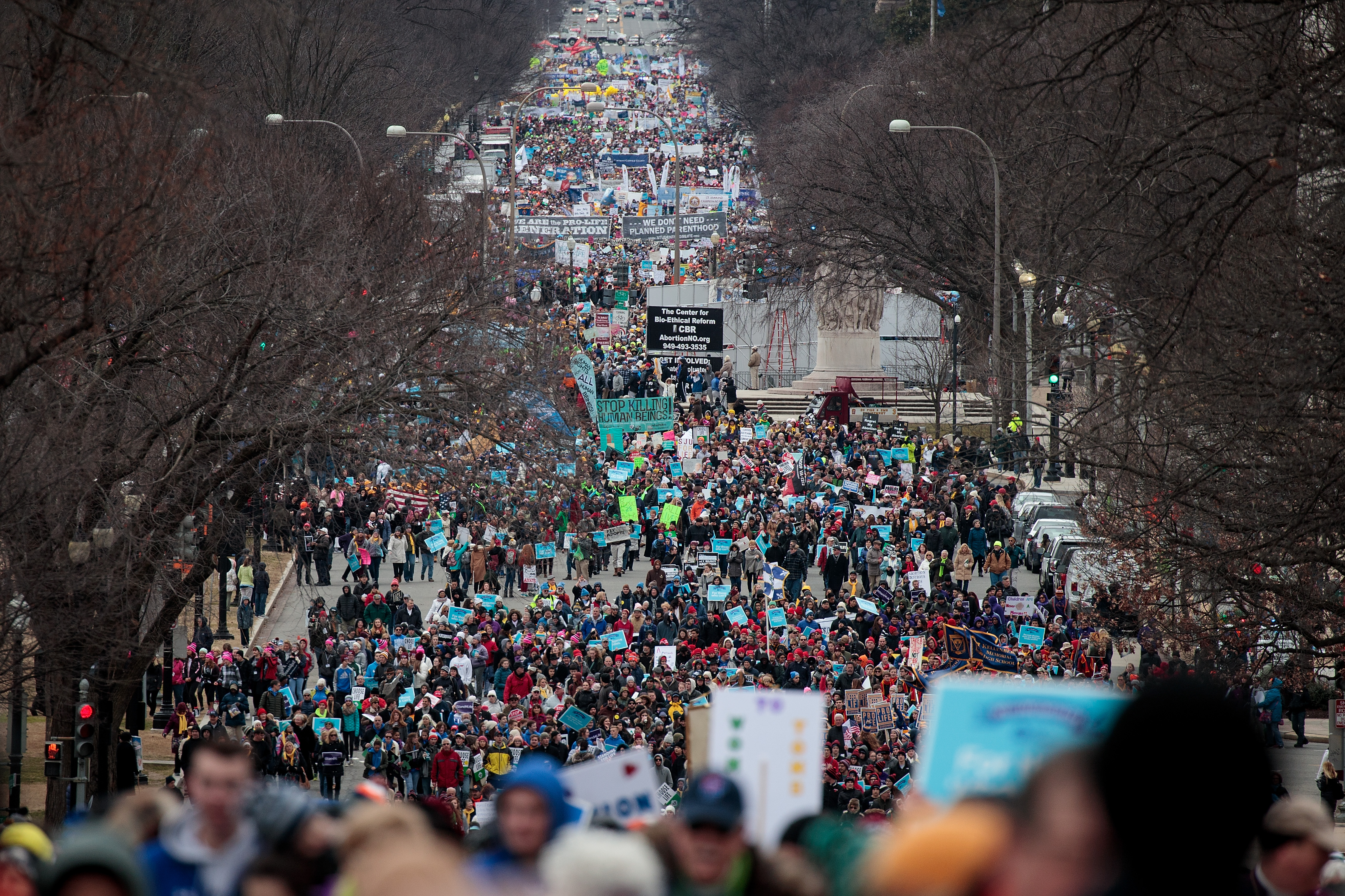 WASHINGTON, DC - JANUARY 27: Thousands of people march on Constitution Avenue during the March for Life, January 27, 2017 in Washington, DC. This year marks the 44th anniversary of the landmark Roe v. Wade Supreme Court case, which established a woman's constitutional right to an abortion. (Photo by Drew Angerer/Getty Images)