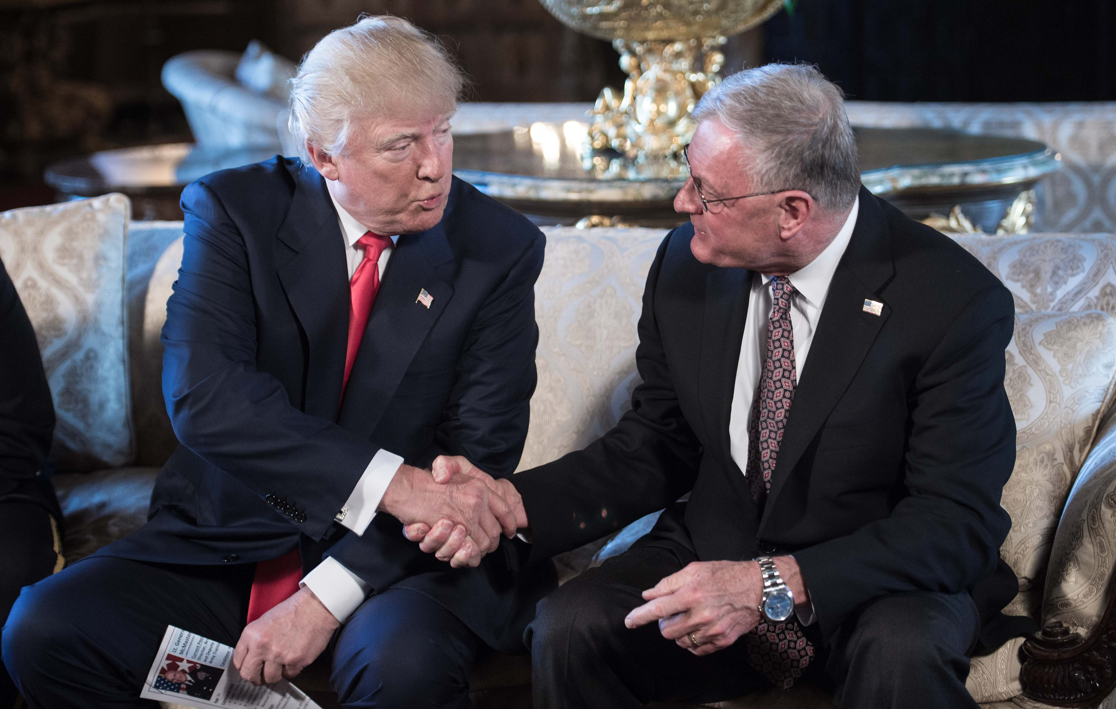 US President Donald Trump shakes hands with Keith Kellogg (R) after announcing him as chief of staff to national security adviser US Army Lieutenant General H.R. McMaster at his Mar-a-Lago resort in Palm Beach, Florida, on February 20, 2017. (NICHOLAS KAMM/AFP/Getty Images)