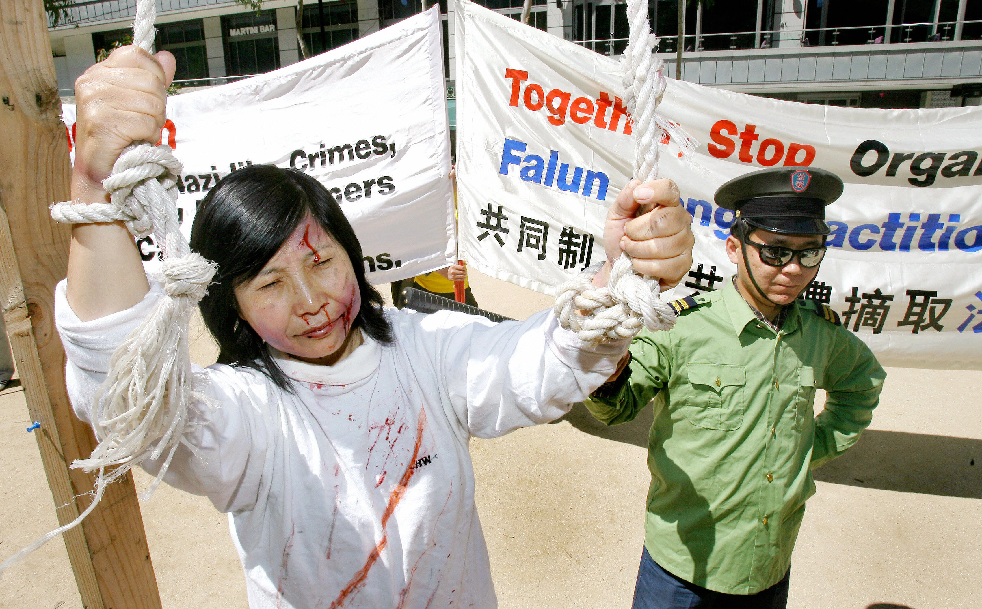 Melbourne, AUSTRALIA: Falun Gong participate in street theatre in a protest over the Chinese government harvesting body organs from arrested Falun Gong practitioners in China as the world's biggest finance conference, the G20 summit, prepares to start, in Melbourne 17 November 2006. A security lockdown in Australia's second city was aimed at preventing unrest at during Group of Twenty (G20) summit this weekend to be attended by the globe's most powerful financial leaders. AFP PHOTO/William WEST (Photo credit should read WILLIAM WEST/AFP/Getty Images)