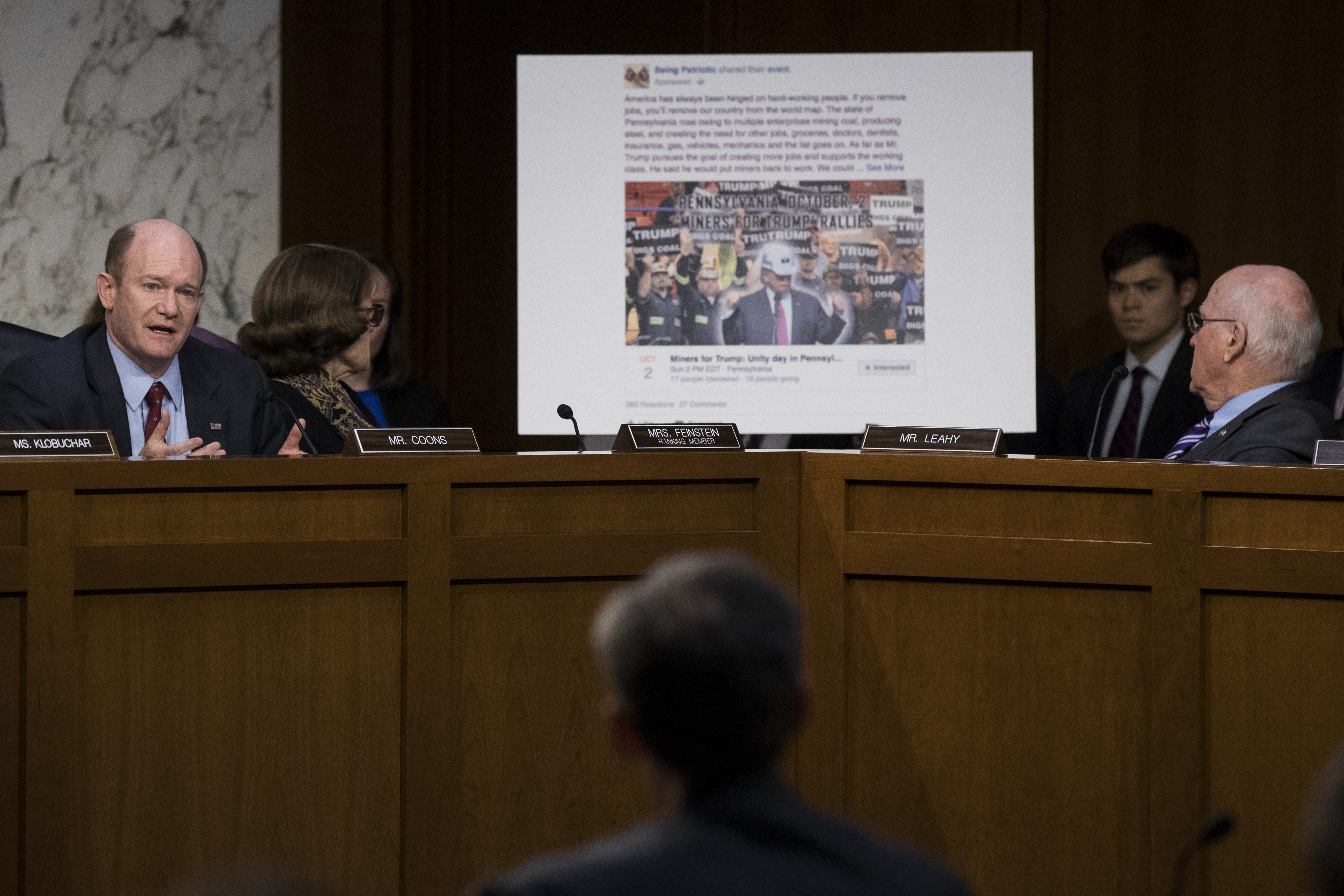 With a Facebook event page featuring a 'Miners For Trump' rally created by Russian operatives displayed behind him, Sen. Chris Coons (D-DE) questions witnesses during a Senate Judiciary Subcommittee on Crime and Terrorism hearing titled 'Extremist Content and Russian Disinformation Online' on Capitol Hill, October 31, 2017 in Washington, DC. (Drew Angerer/Getty Images)