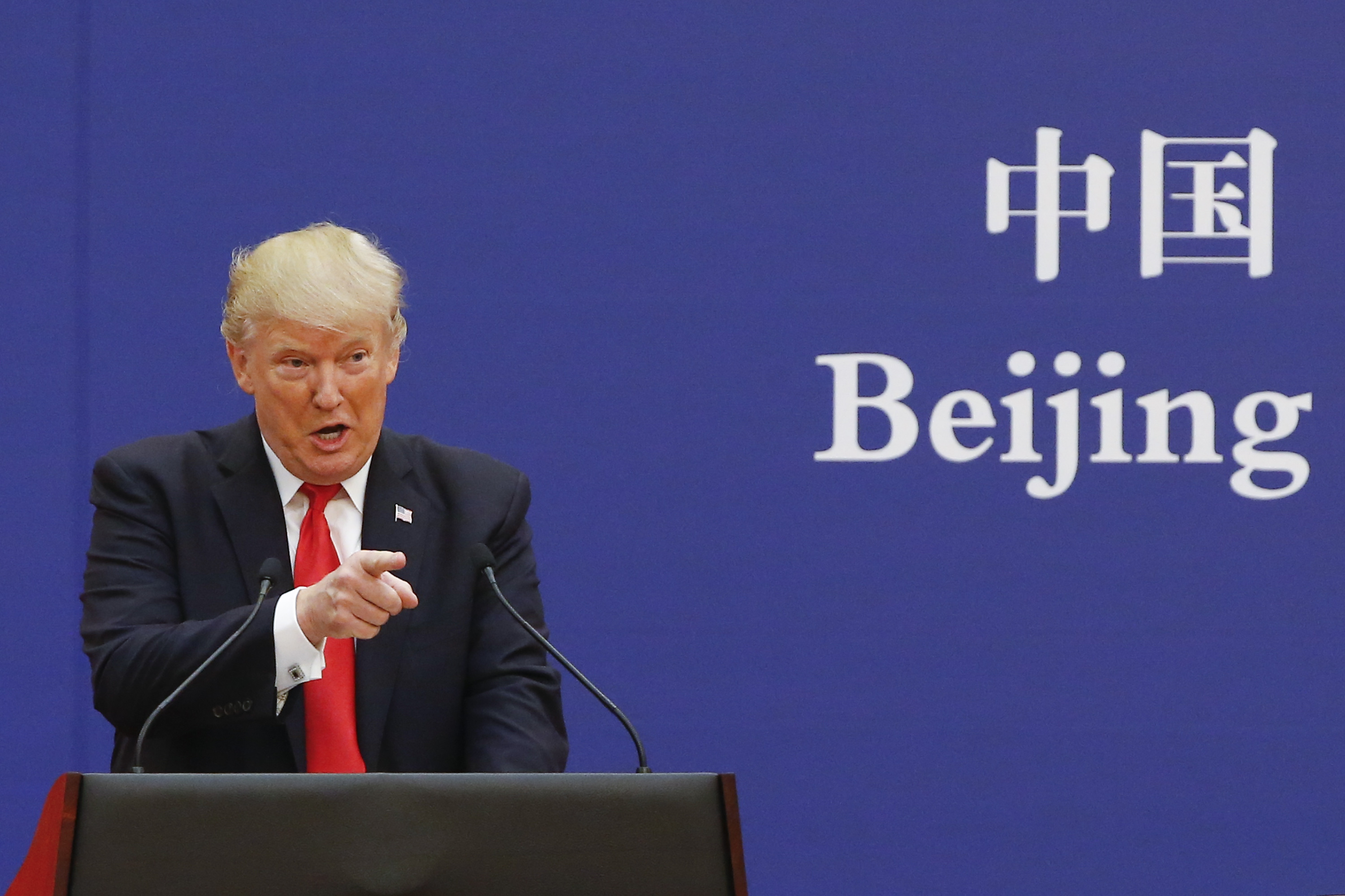 U.S. President Donald Trump and China's President Xi Jinping (not shown) speak to business leaders at the Great Hall of the People on November 9, 2017 in Beijing, China. Trump is on a 10-day trip to Asia. (Photo by Thomas Peter-Pool/Getty Images)