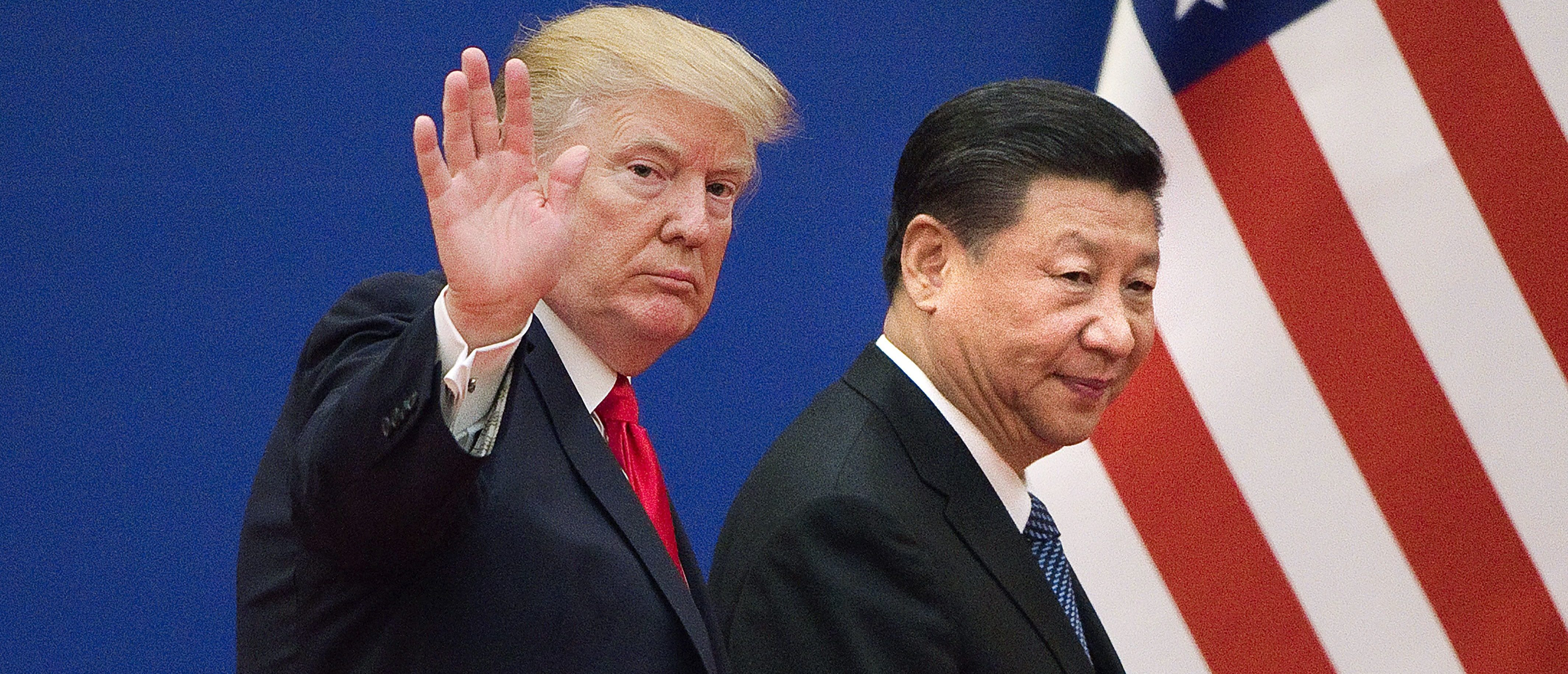 "US President Donald Trump (L) and China's President Xi Jinping leave a business leaders event at the Great Hall of the People in Beijing on November 9, 2017. Donald Trump urged Chinese leader Xi Jinping to work ""hard"" and act fast to help resolve the North Korean nuclear crisis, during their meeting in Beijing on November 9, warning that ""time is quickly running out"". / AFP PHOTO / Nicolas ASFOURI (Photo credit should read NICOLAS ASFOURI/AFP/Getty Images)"