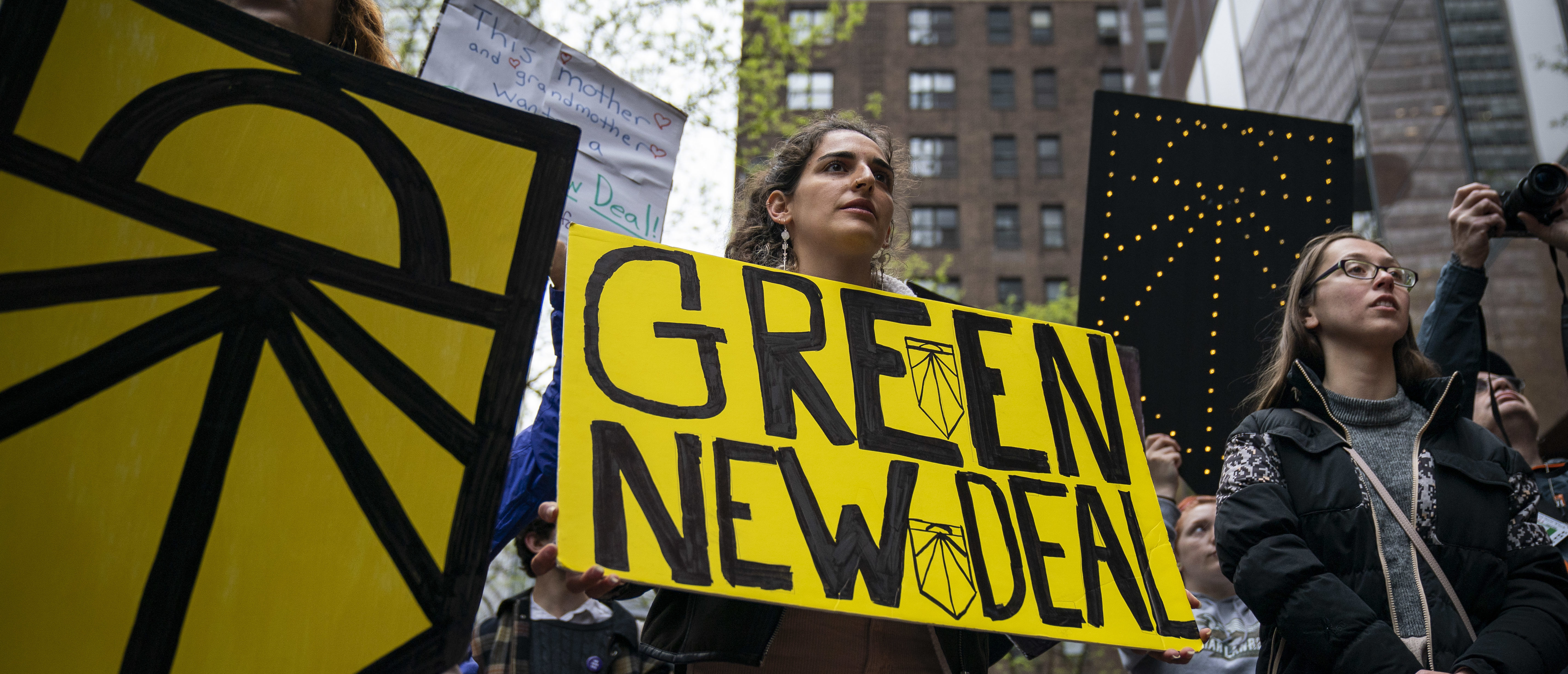 "Activists rally in support of proposed ""Green New Deal"" legislation outside of Senate Minority Leader Chuck Schumer's New York City office, April 30, 2019 in New York City. (Photo by Drew Angerer/Getty Images)"