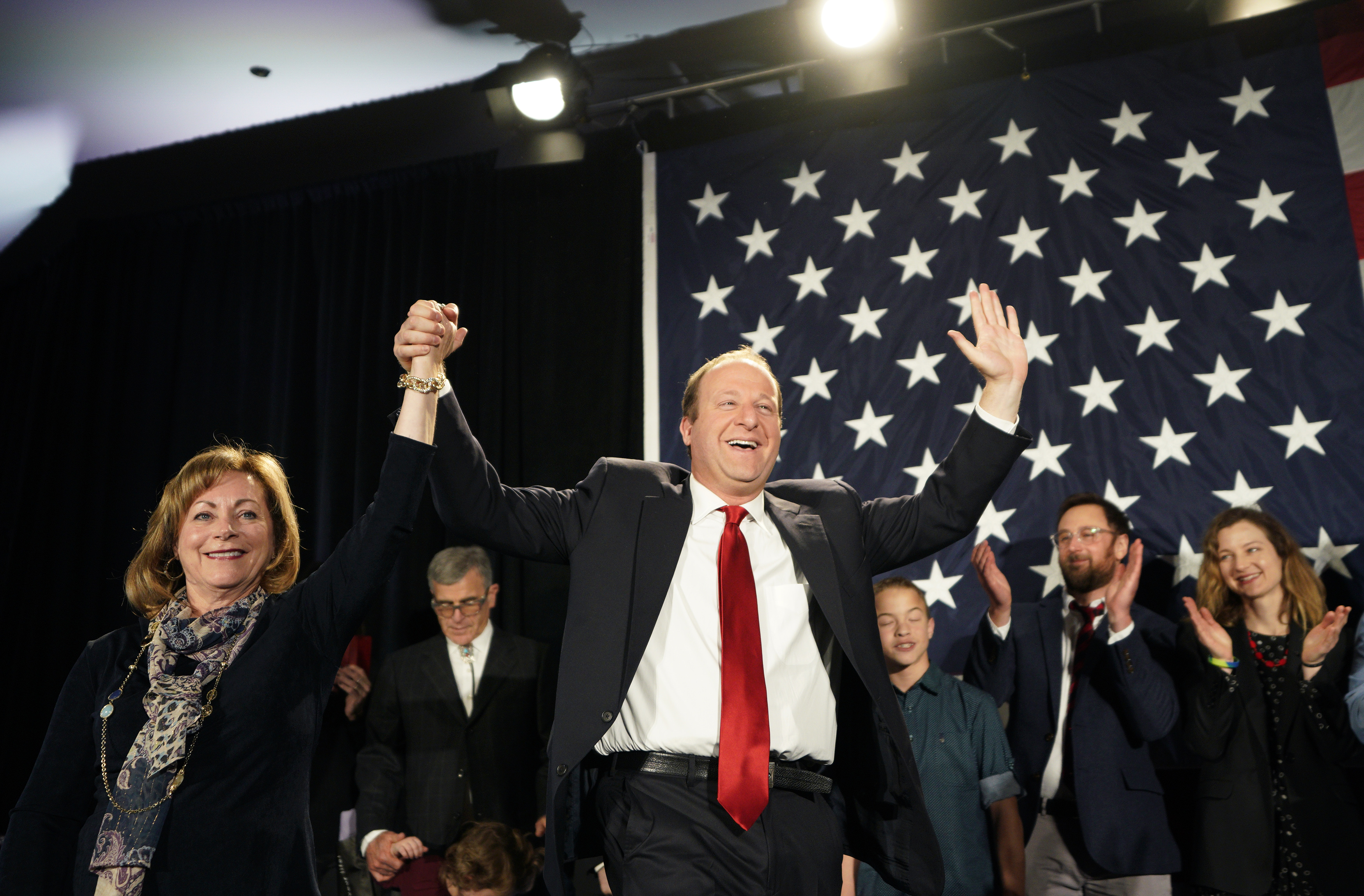 Democratic Colorado Governor-elect Jared Polis arrives onstage with running mate Dianne Primavera on November 6, 2018 in Denver, Colorado. (Rick T. Wilking/Getty Images)