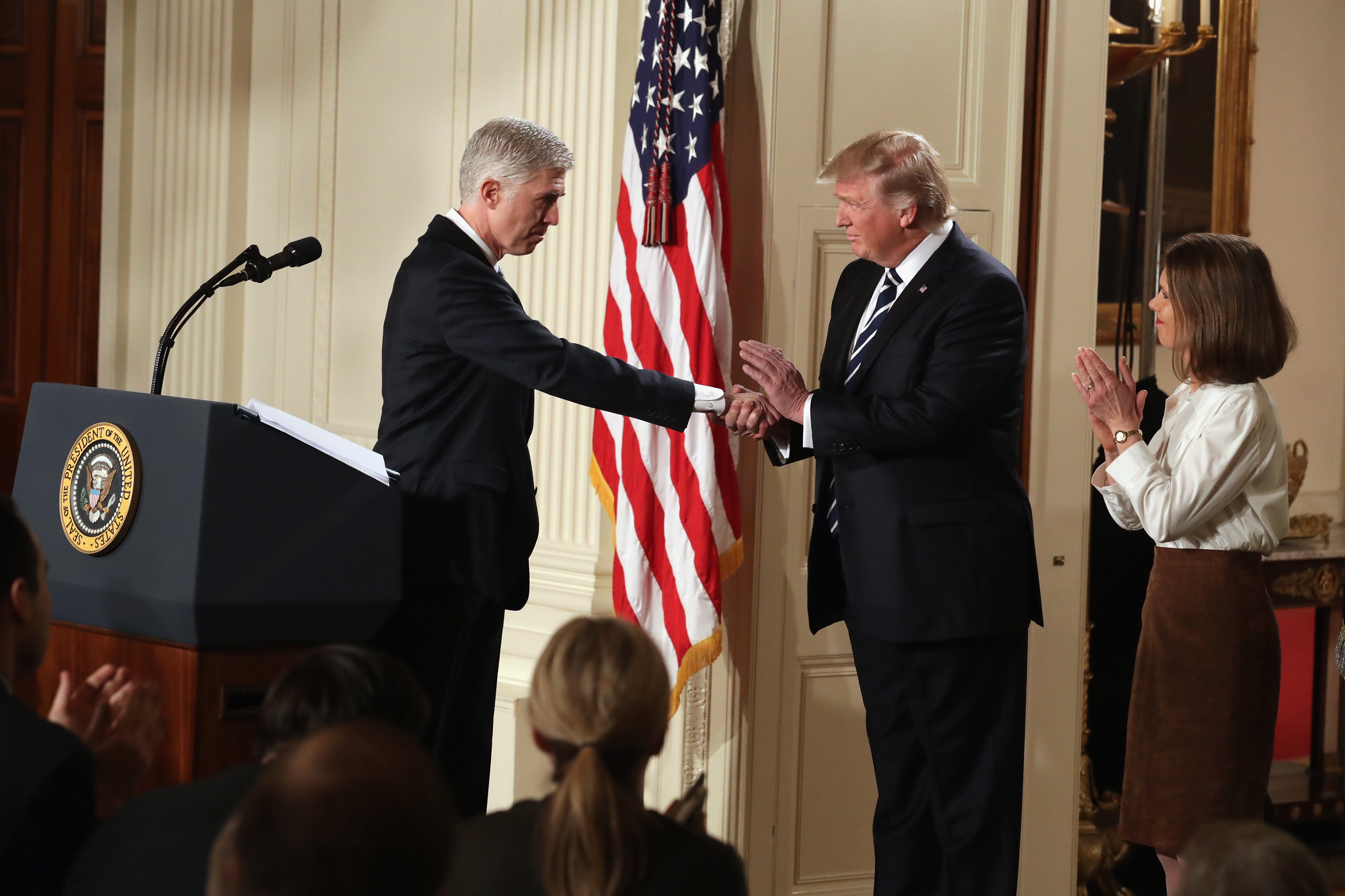 President Donald Trump shakes hands with Justice Neil Gorsuch after nominating him to the Supreme Court on January 31, 2017. (Chip Somodevilla/Getty Images)