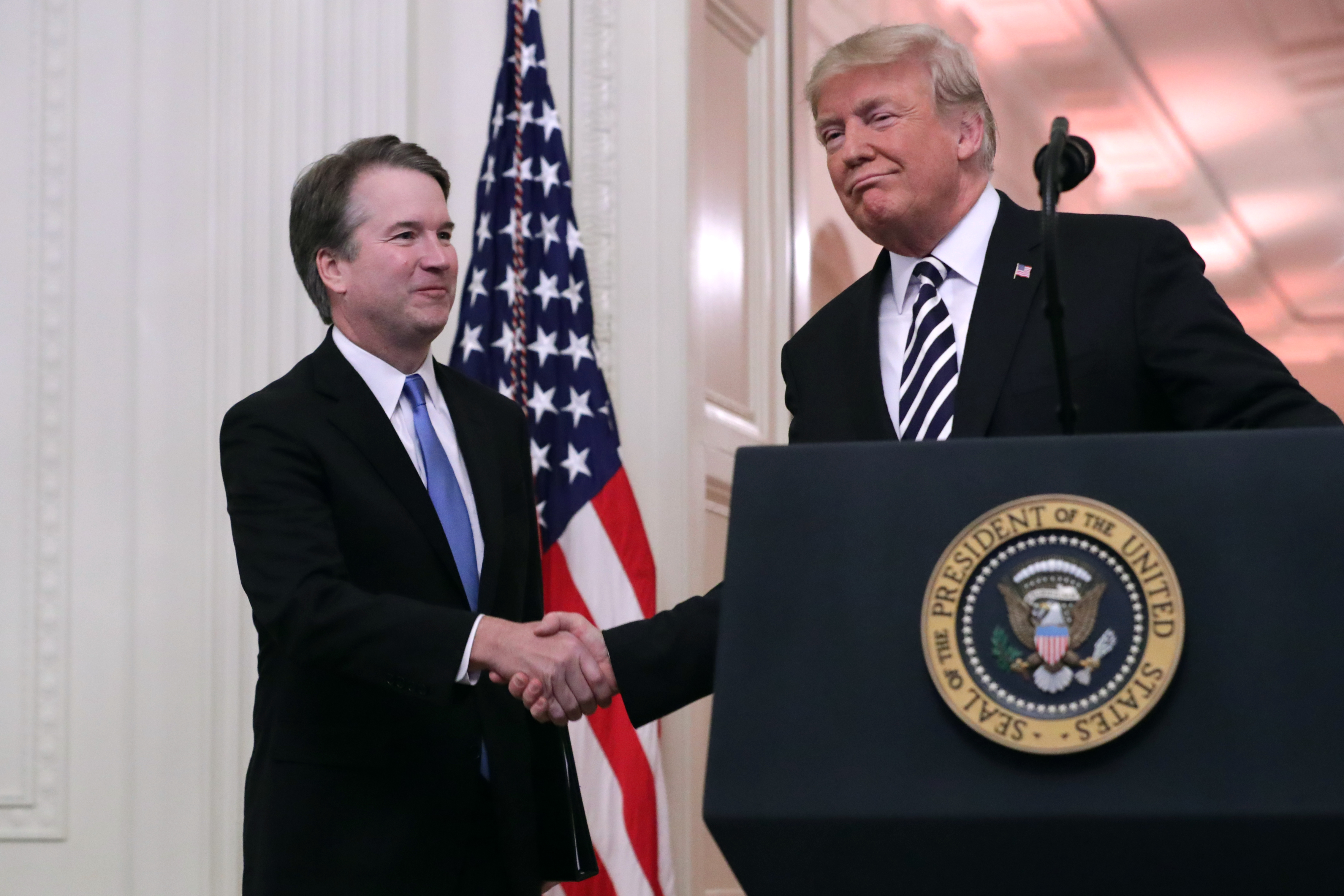 Justice Brett Kavanaugh shakes hands with President Donald Trump at the White House on October 8, 2018. (Chip Somodevilla/Getty Images)