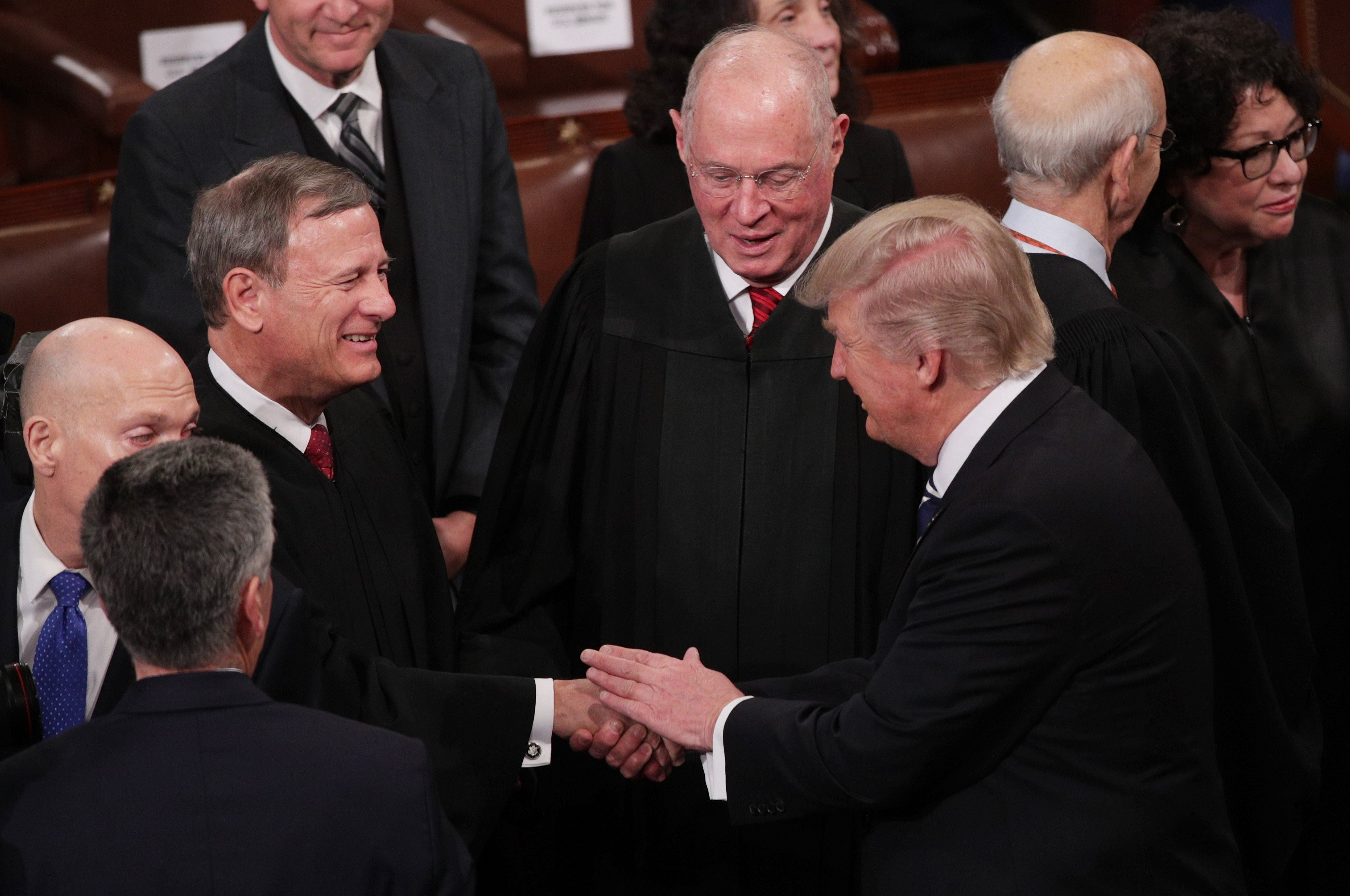 President Donald Trump shakes hands with Chief Justice John Roberts on February 28, 2017. (Alex Wong/Getty Images)