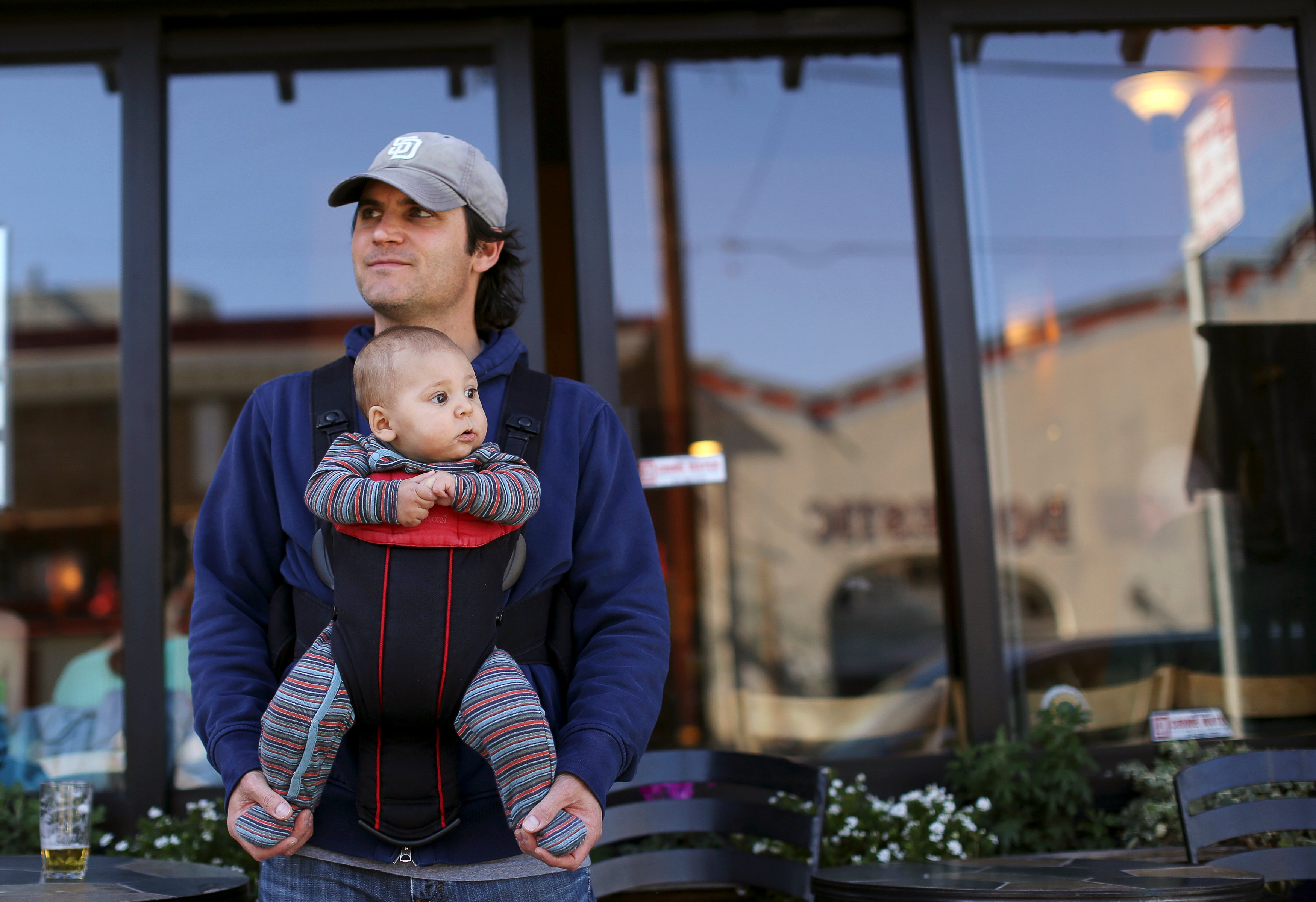 Steve Caniglia holds his six-month-old son, Boden, in San Francisco, California February 19, 2014.