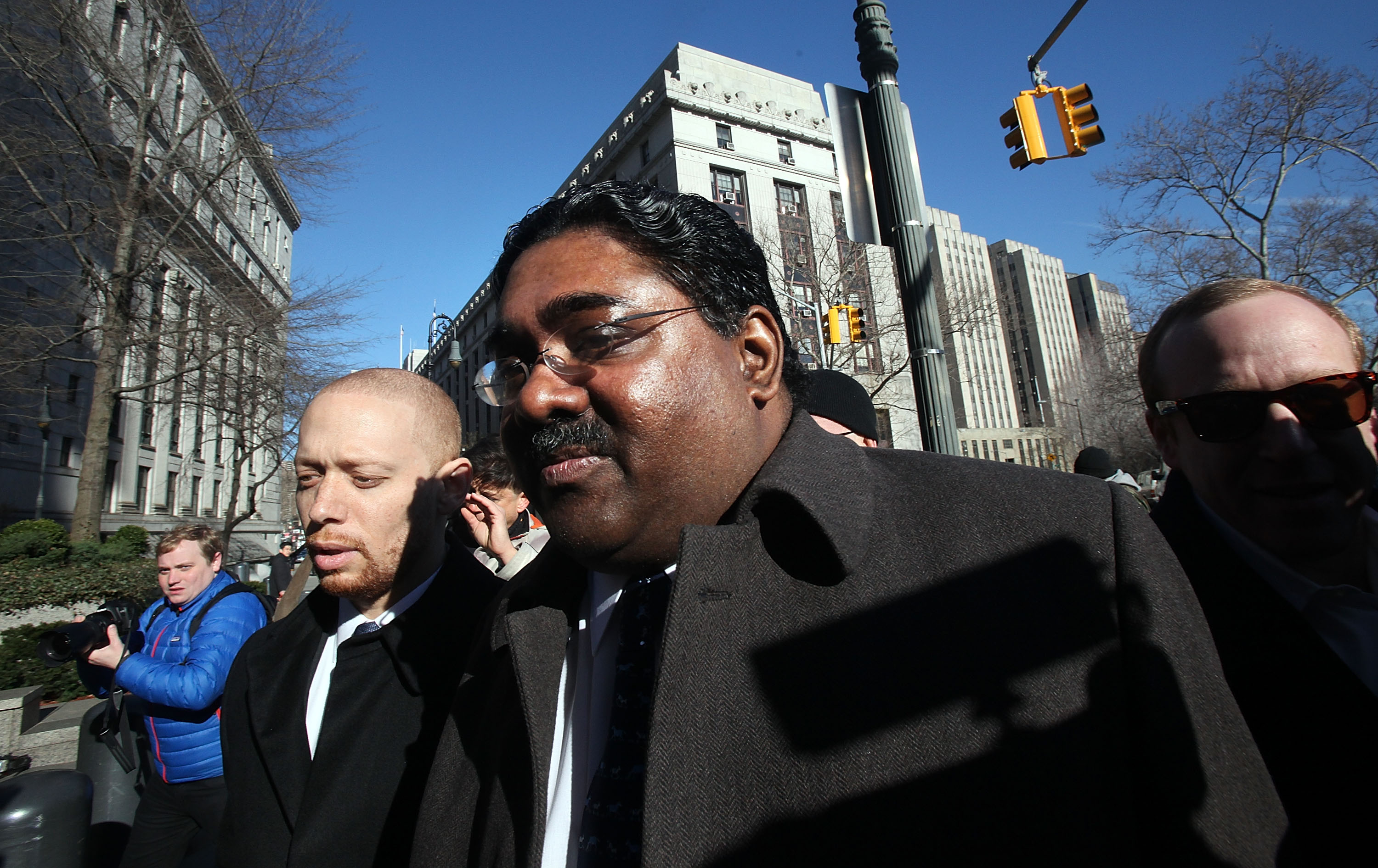 Billionaire Galleon Group hedge fund cofounder Raj Rajaratnam (C) enters Manhattan Federal Court at the start of his trial on insider trading charges March 8, 2011 in New York City. Prosecutors allege that Rajaratnam pocketed $45m by illegally trading on insider stock tips. (Photo by Mario Tama/Getty Images)
