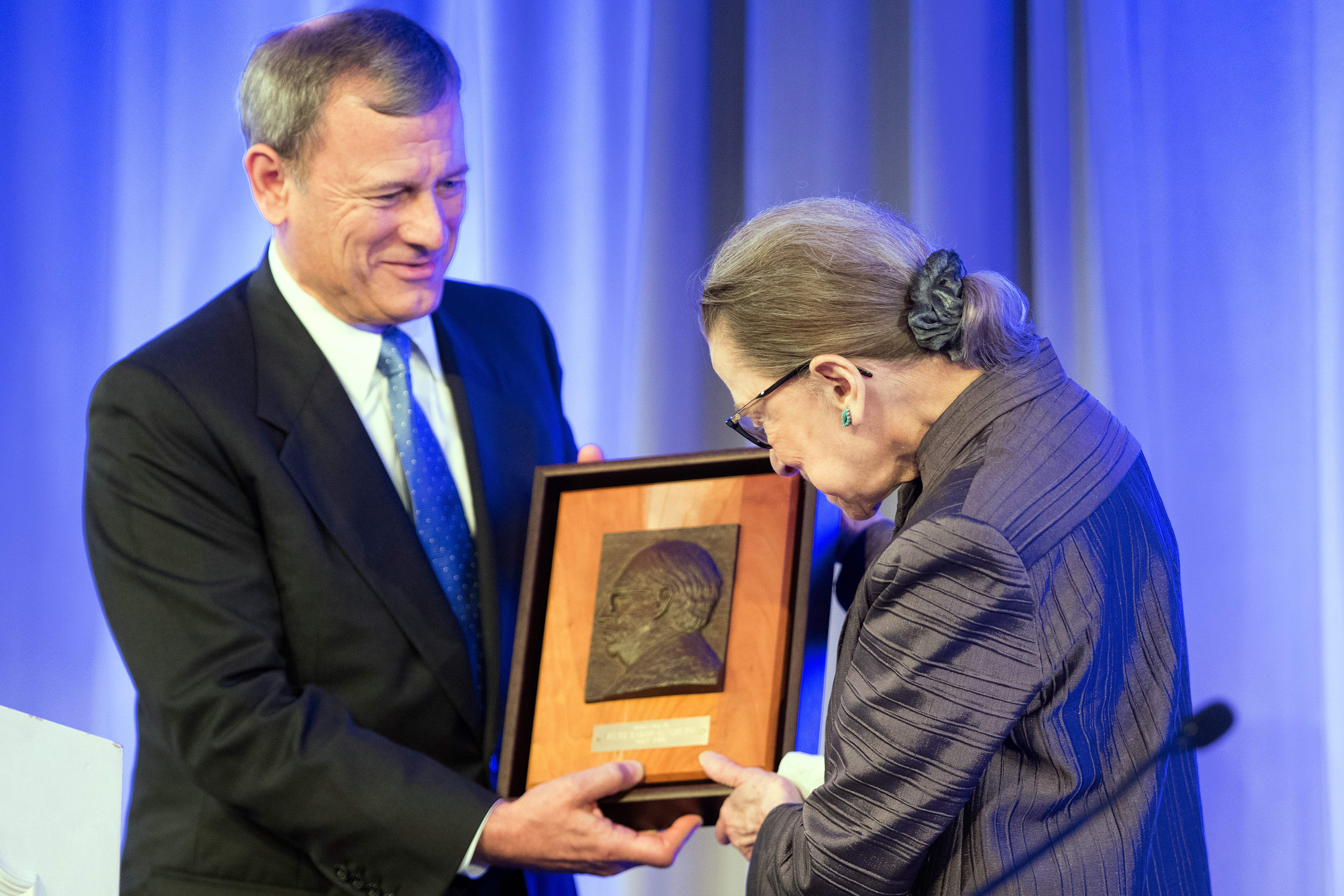 Justice Ruth Bader Ginsburg receives the American Law Institute's Henry J. Friendly Medal from Chief Justice John Roberts on May 21, 2018. (Jim Watson/AFP/Getty Images)