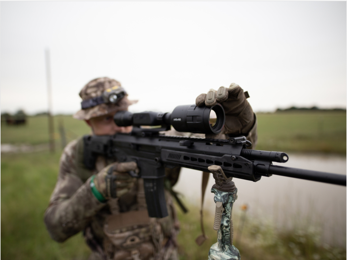 A hunter readies his Bushmaster ACR rifle equipped with a digital scope from ATN. (ATN/Instagram)