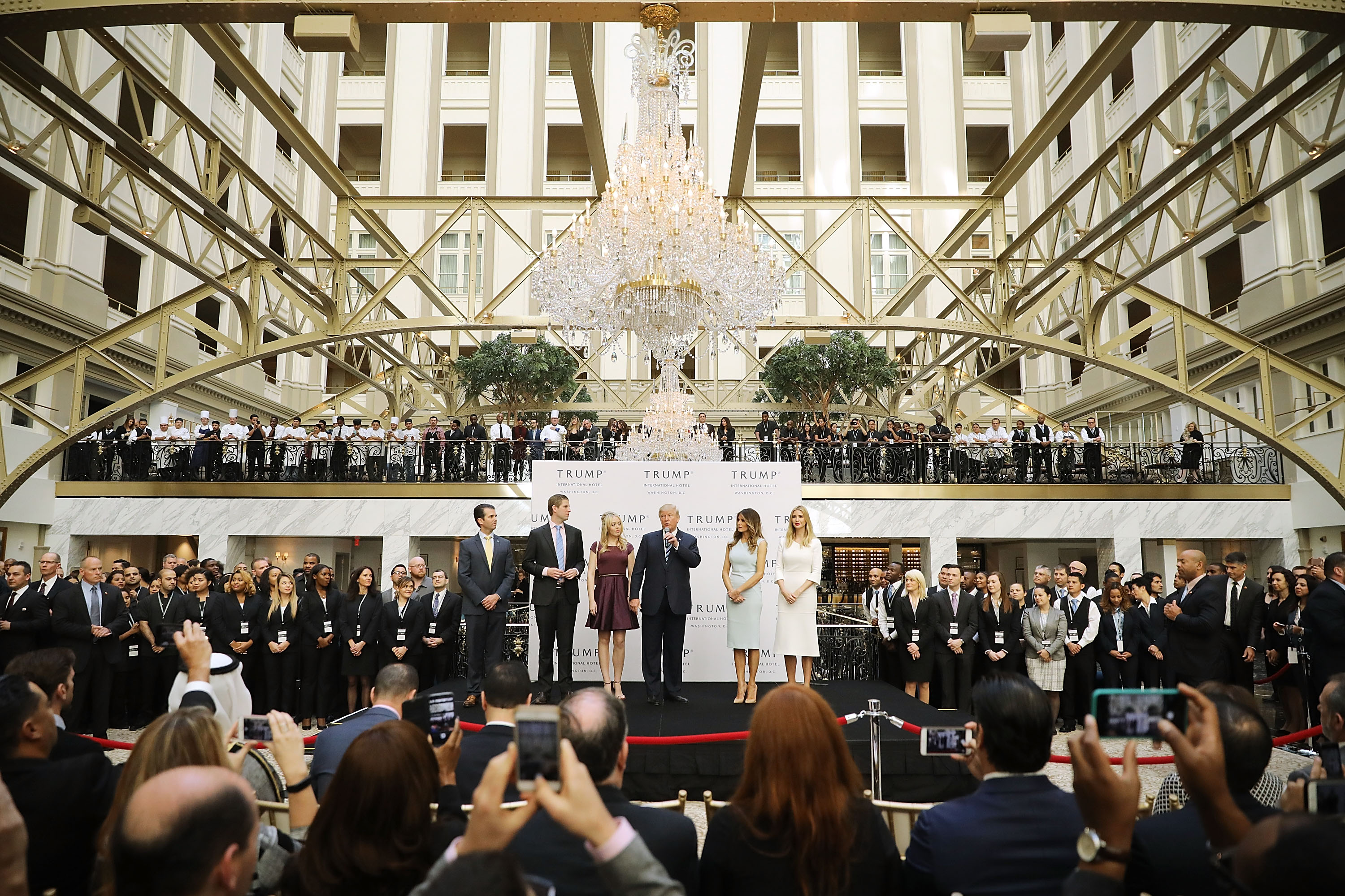 President Donald Trump and his family cut the ribbon at the new Trump International Hotel in Washington, D.C. on October 26, 2016. (Chip Somodevilla/Getty Images)