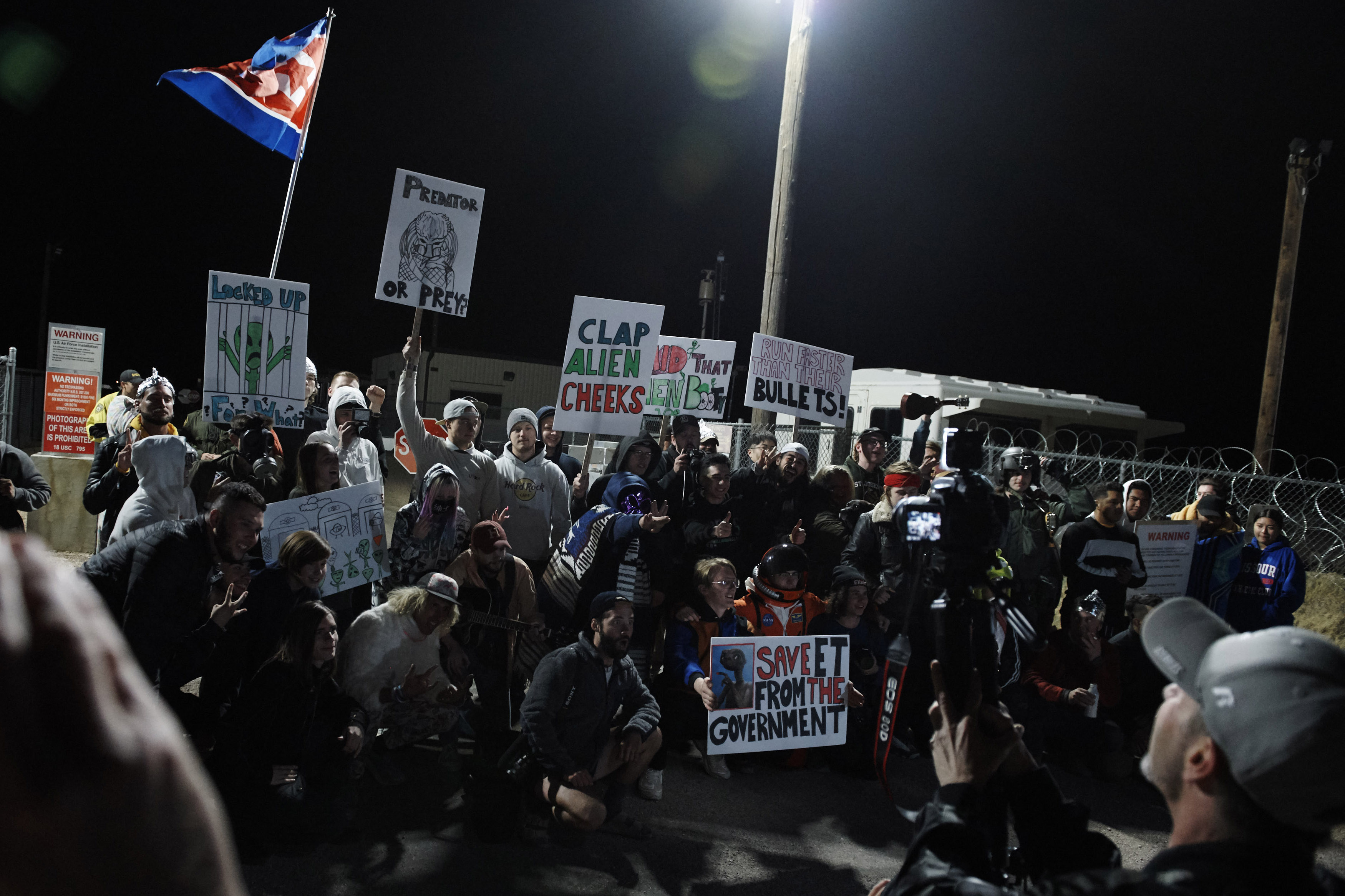 "Alien-hunters gather to ""storm"" Area 51 at an entrance to the military facility near Rachel, Nevada on September 20, 2019. (Photo by BRIDGET BENNETT/AFP/Getty Images)"