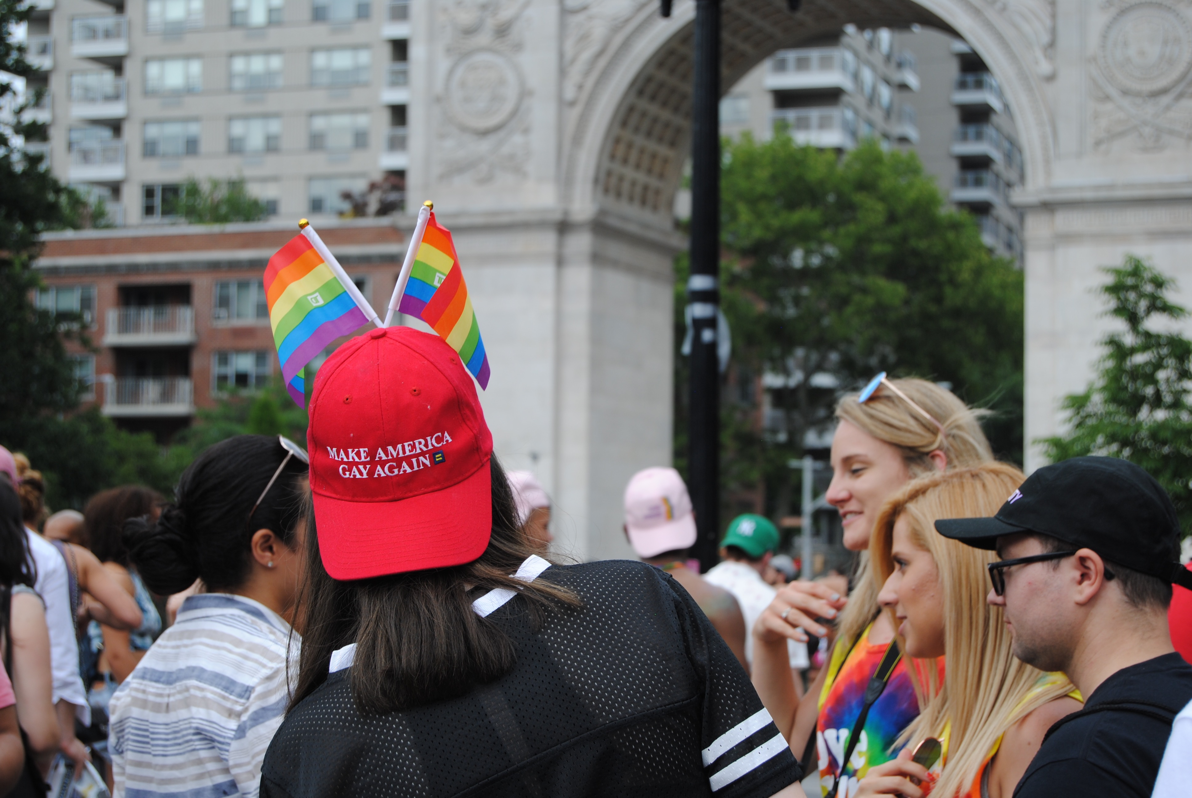 "New York City, New York / USA - June 24 2018: In Washington Square Park, during NYC Pride, this red ""Make America Gay Again"" hat parodies Donald Trump's campaign slogan, ""Make America Great Again"". - Image (Shutterstock/ErinAlexisRandolph)"