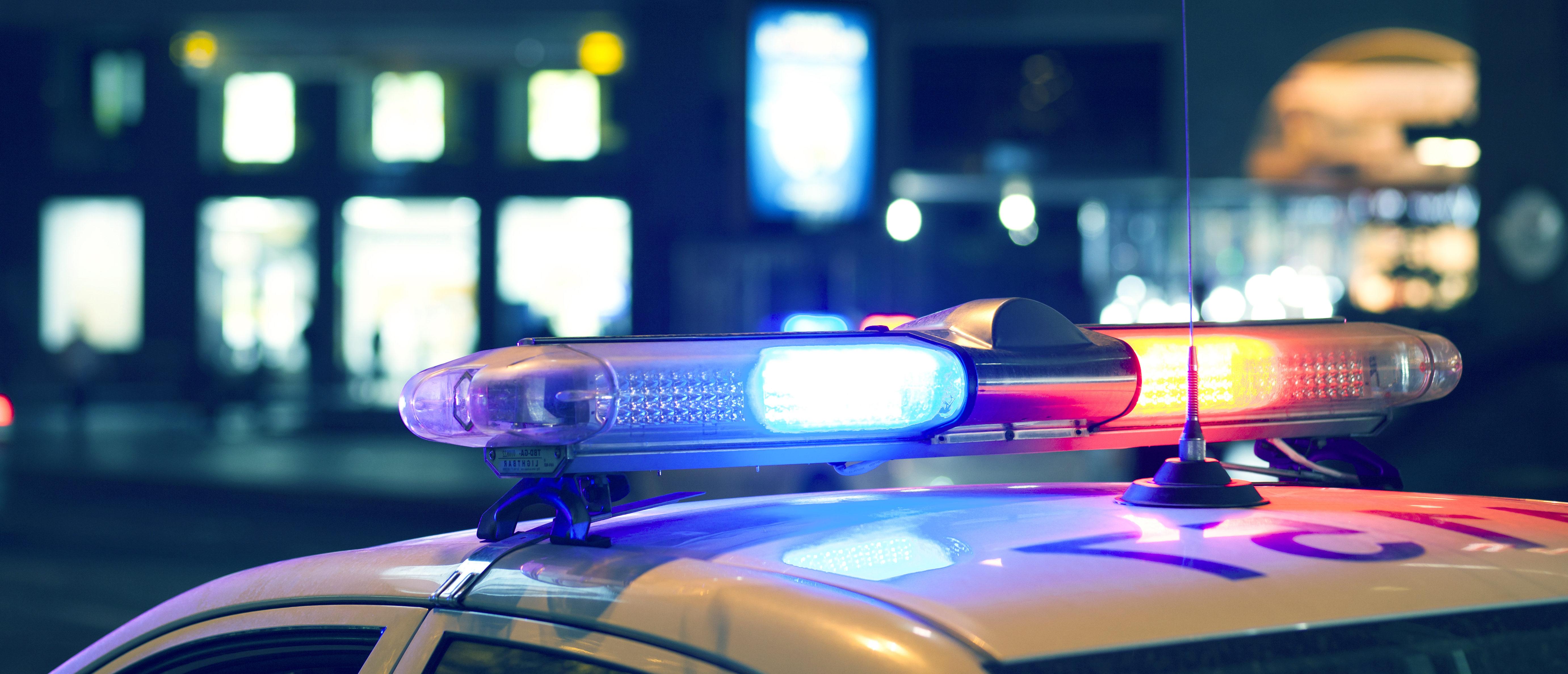 police lights. (Shutterstock/Tiko Aramyan)