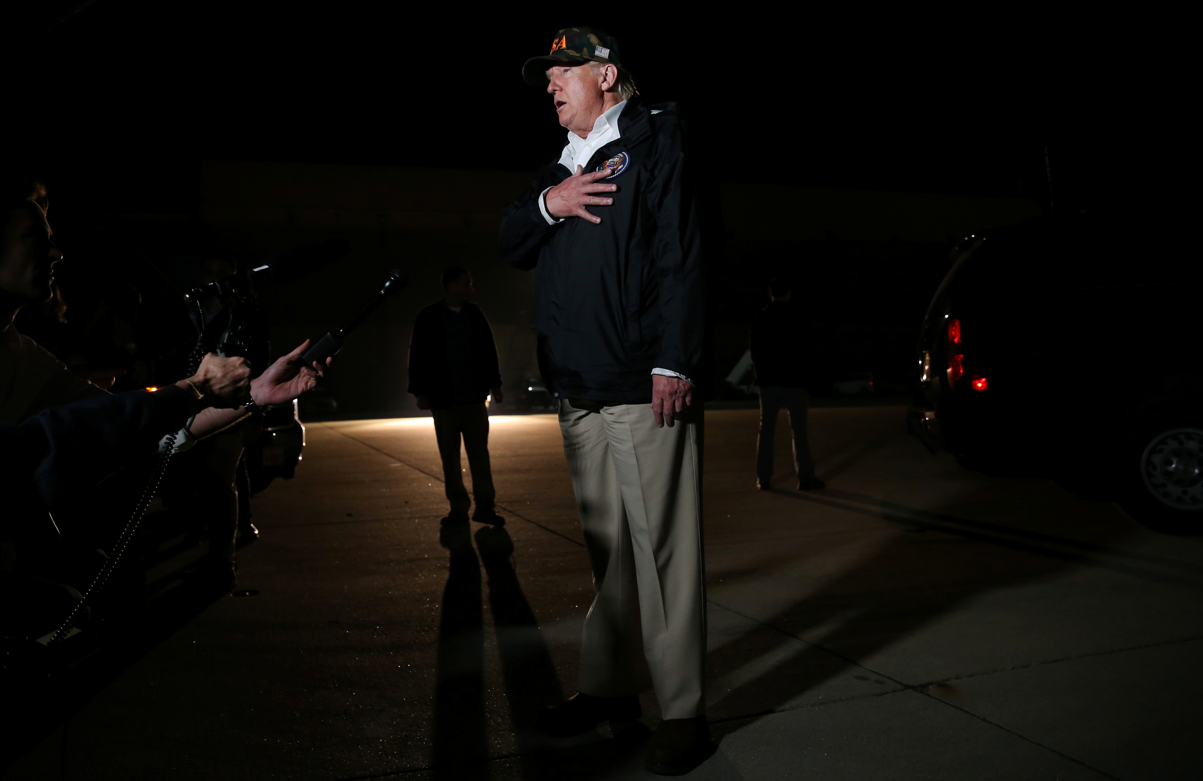 U.S. President Donald Trump speaks to the media after a day of touring neighborhoods devastated by the wildfires and meeting with families and friends of the victims of the Thousand Oaks shooting, at Naval Air Station Point Mugu near Malibu, California, U.S., November 17, 2018. REUTERS/ Leah Millis