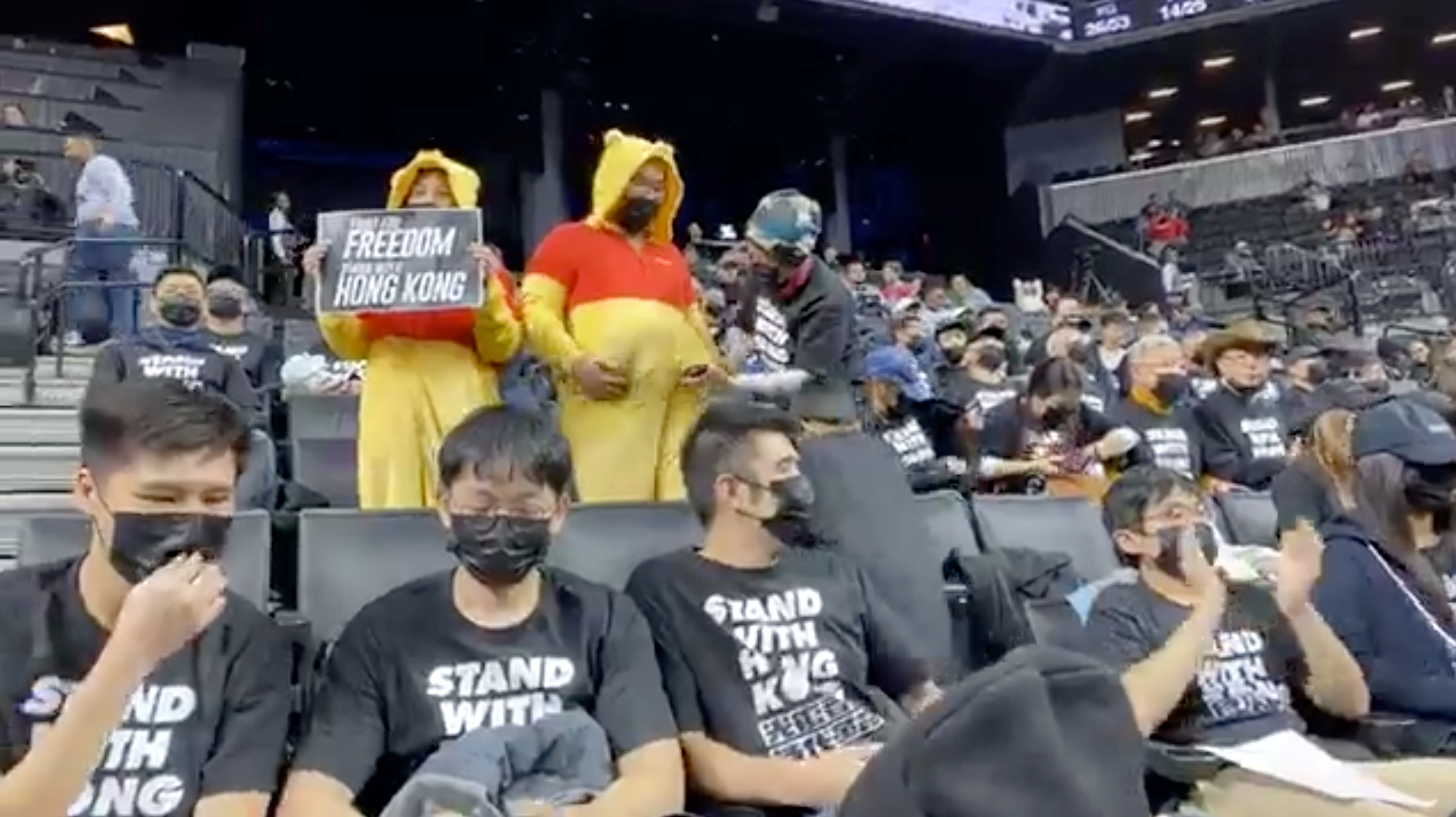 Pro-democracy protesters supporting Hong Kong are seen on the stands of Barclays Center during a game between the Brooklyn Nets and Toronto Raptors, in New York City, New York, U.S., October 18, 2019 in this still image obtained from social media video on Oct. 19, 2019. NY4HK – New Yorkers Supporting Hong Kong /via REUTERS