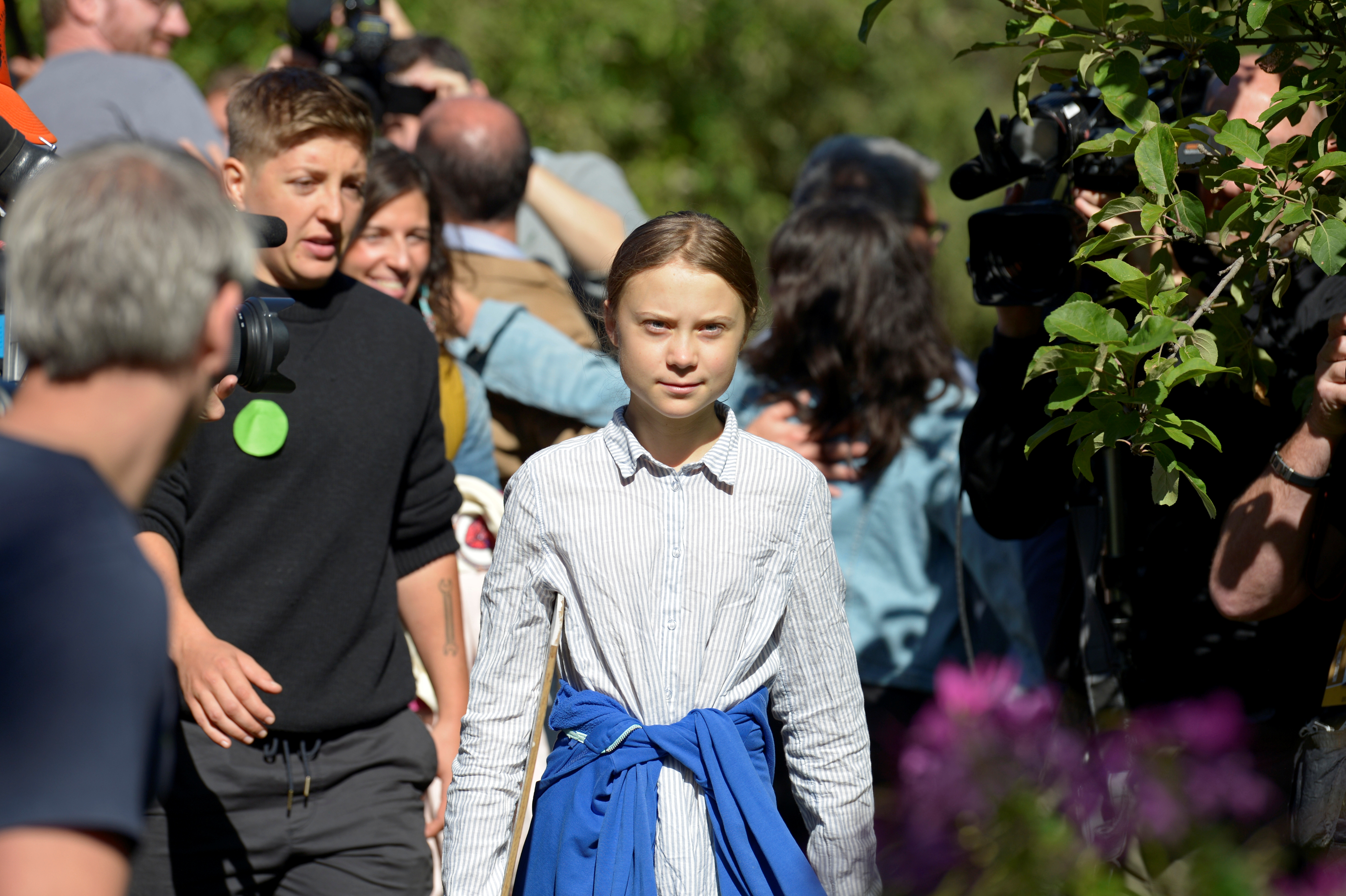 Climate change teen activist Greta Thunberg walks past media members before joining a climate strike march in Montreal, Quebec, Canada September 27, 2019. REUTERS/Andrej Ivanov