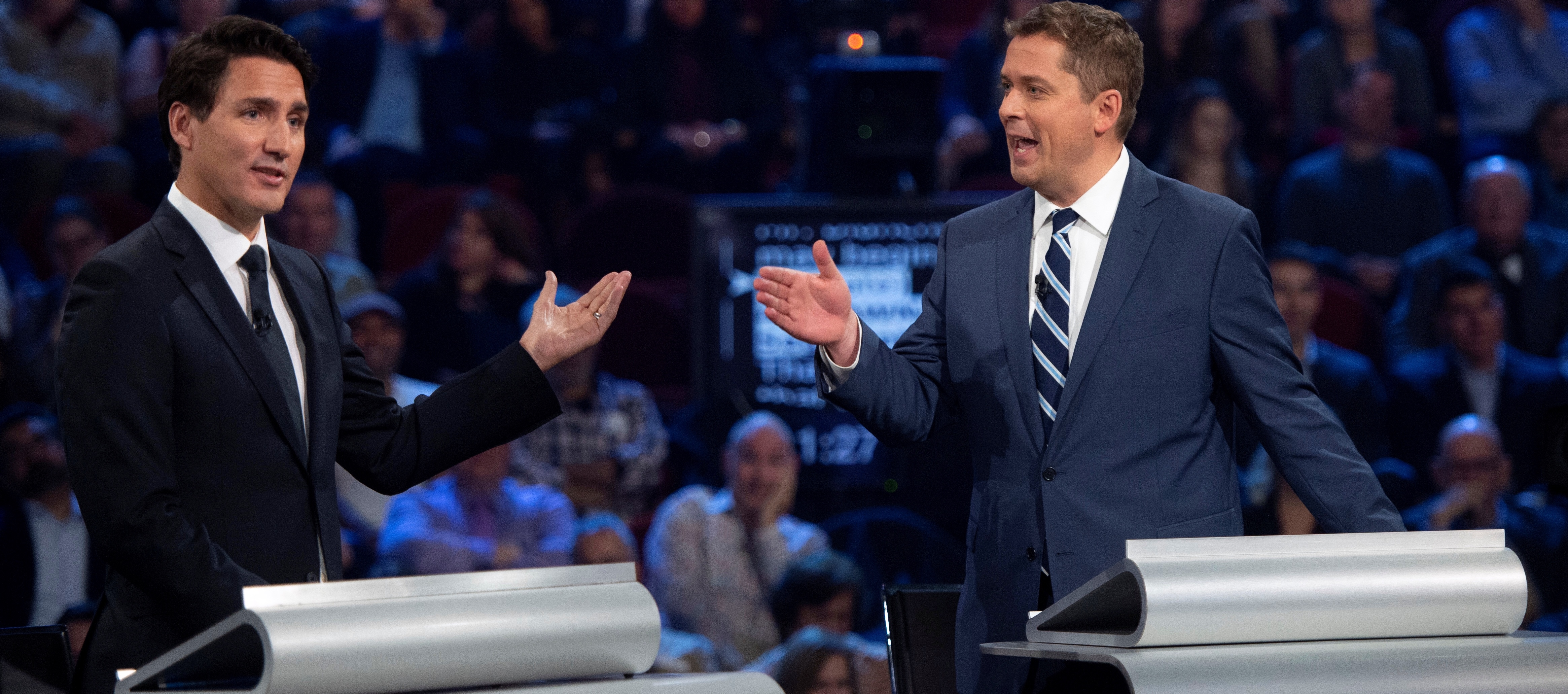 Liberal leader Justin Trudeau and Conservative leader Andrew Scheer debate a point during the Federal leaders debate in Gatineau, Quebec, Canada October 7, 2019. Picture taken October 7, 2019. Sean Kilpatrick/Pool via REUTERS