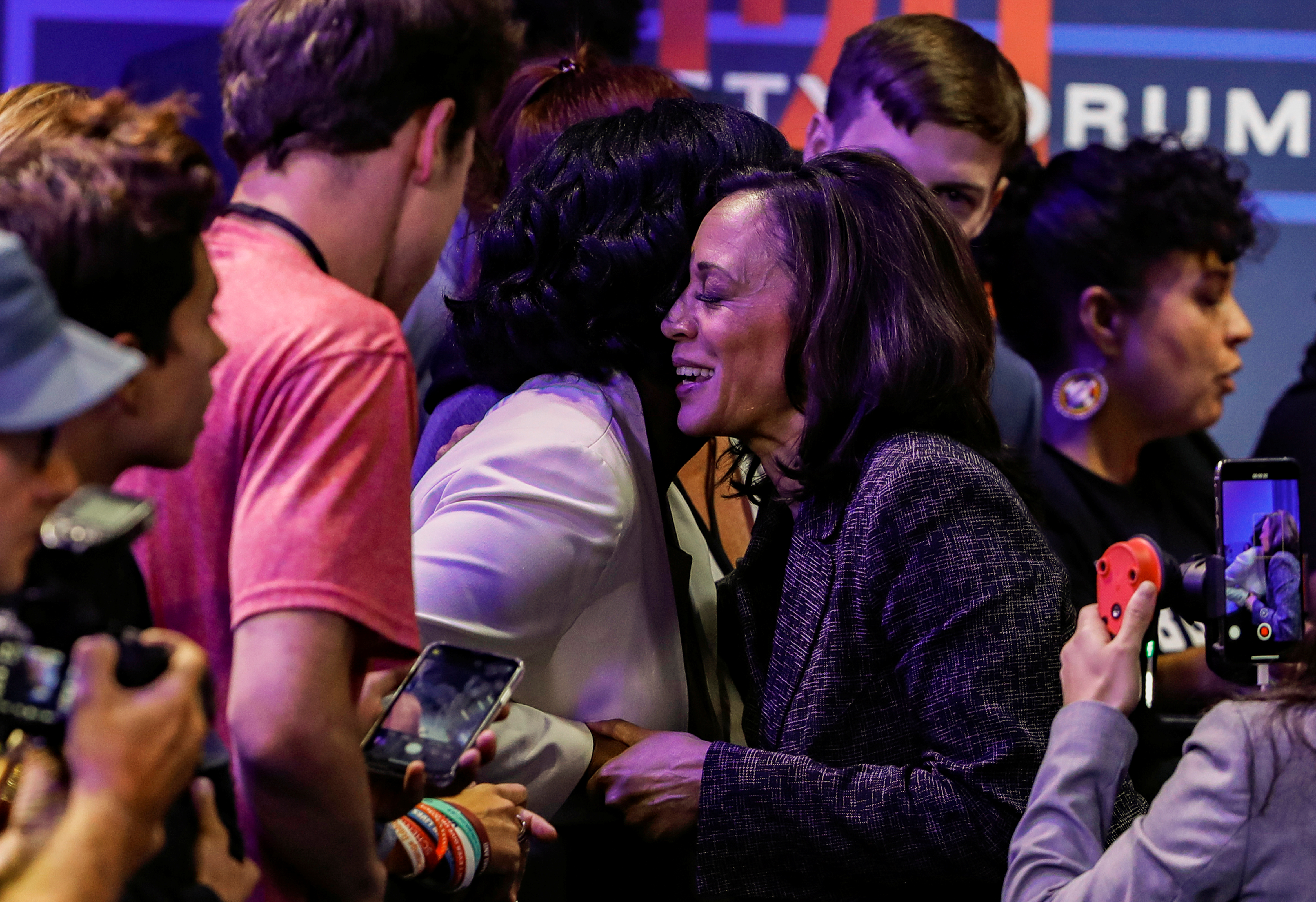 U.S. Democratic presidential candidate Sen. Kamala Harris (D-CA) meets with an audience member during a forum held by gun safety organizations the Giffords group and March For Our Lives in Las Vegas, Nevada, U.S. October 2, 2019. REUTERS/Steve Marcus