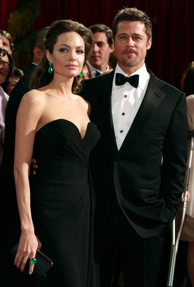 "Brad Pitt (R), best actor nominee for ""The Curious Case of Benjamin Button,"" and Angelina Jolie, best actress nominee for ""Changeling,"" arrive at the 81st Academy Awards in Hollywood, California February 22, 2009.Pitt is in a classic Tom Ford tuxedo while Jolie is in an Elie Saab gown.REUTERS/Jason Reed"