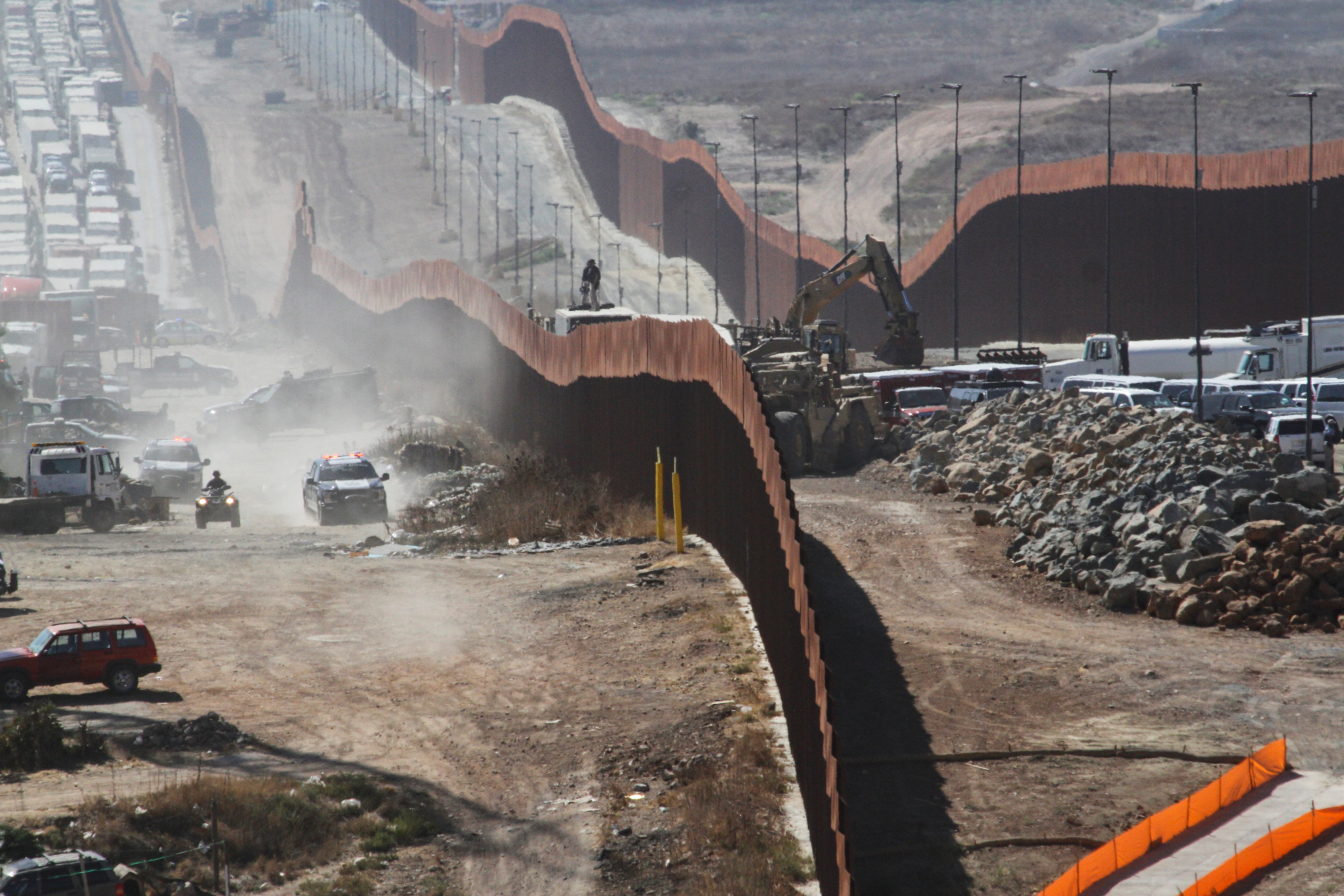 A general view shows Mexican security forces keeping watch at the border fence between Mexico and the United States, ahead of the visit of U.S. President Donald Trump to a section of the border wall in Otay Mesa, California, as pictured from Tijuana