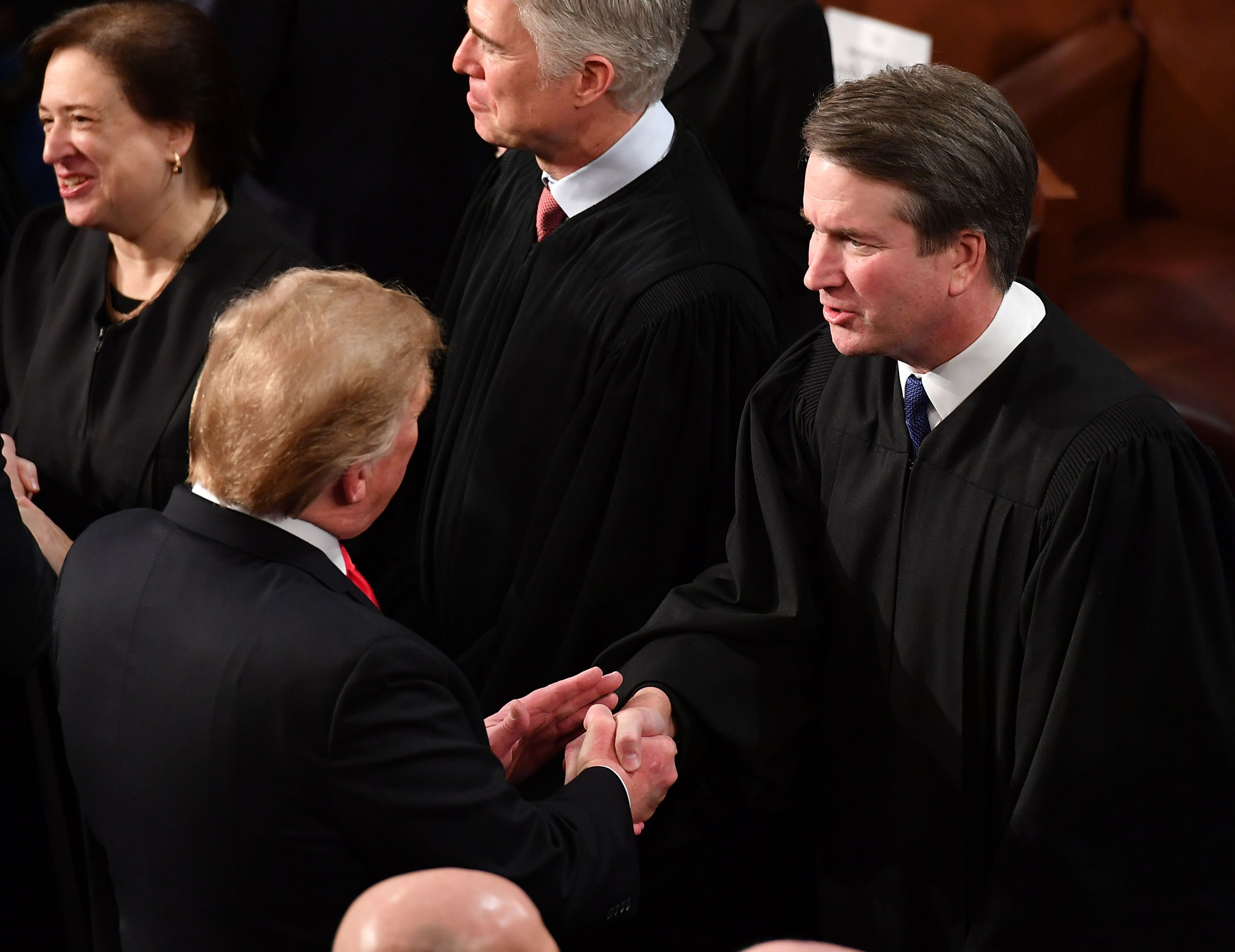 President Donald Trump shakes hands with Justice Brett Kavanaugh before delivering the State of the Union address on February 5, 2019. (Mandel Ngan/AFP/Getty Images)