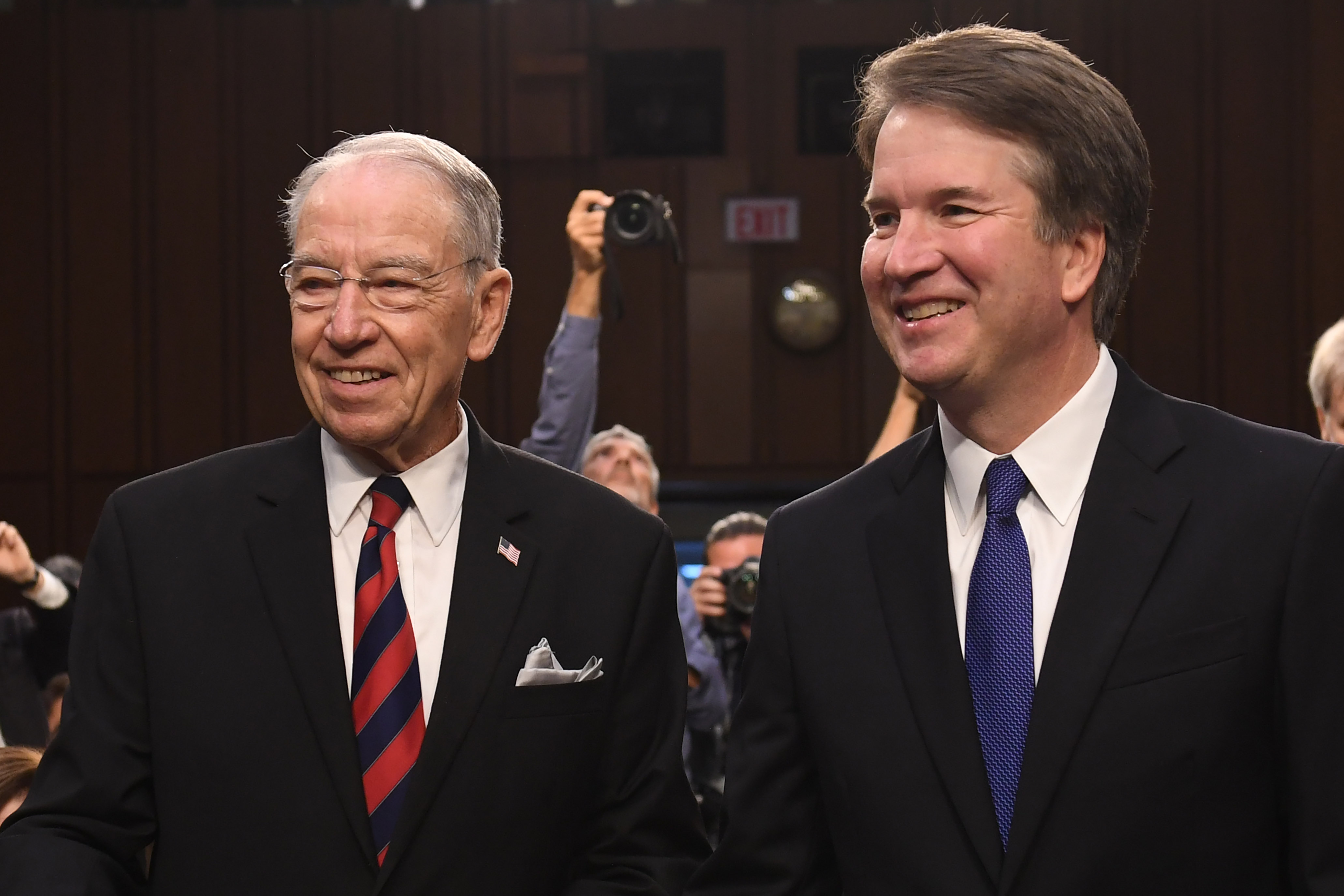 Justice Brett Kavanaugh stands with Sen. Chuck Grassley as he arrives for his confirmation hearing on September 4, 2018. (Saul Loeb/AFP/Getty Images)