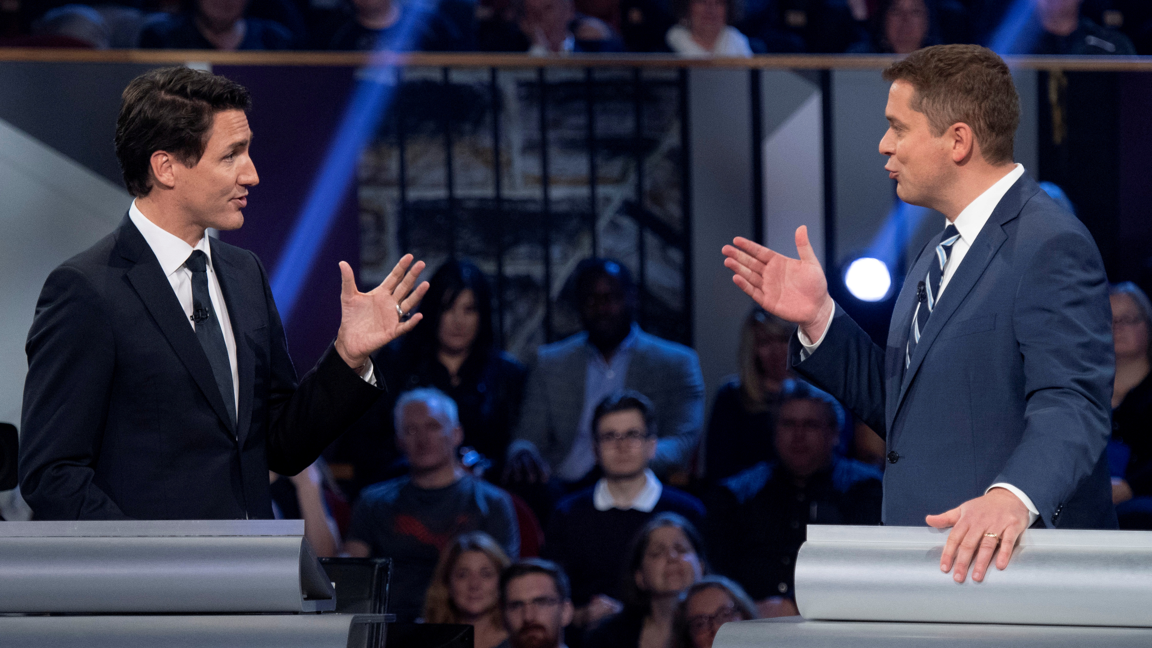 Conservative leader Andrew Scheer and Liberal leader and Canadian Prime Minister Justin Trudeau gesture to each other during the Federal leaders debate in Gatineau, Quebec, Canada October 7, 2019. Justin Tang/Pool via REUTERS