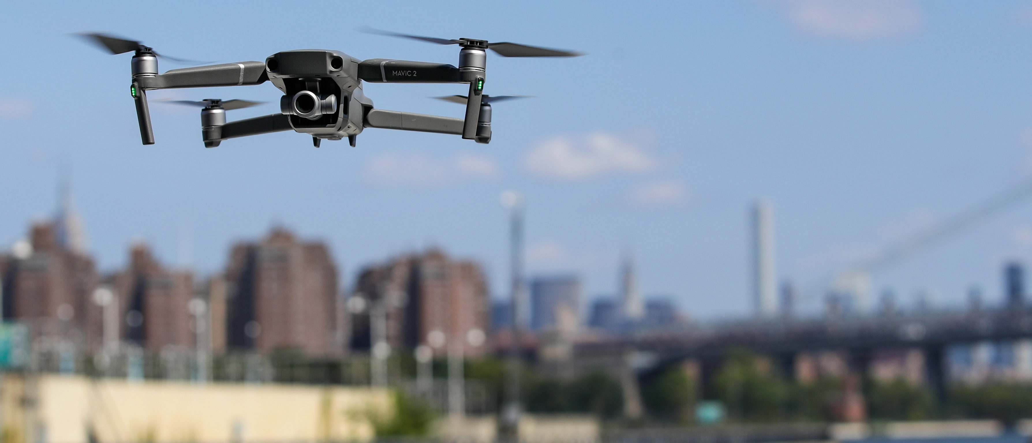 A new DJI Mavic Zoom drone flies during a product launch event at the Brooklyn Navy Yard, August 23, 2018 in New York City. (Photo by Drew Angerer/Getty Images)