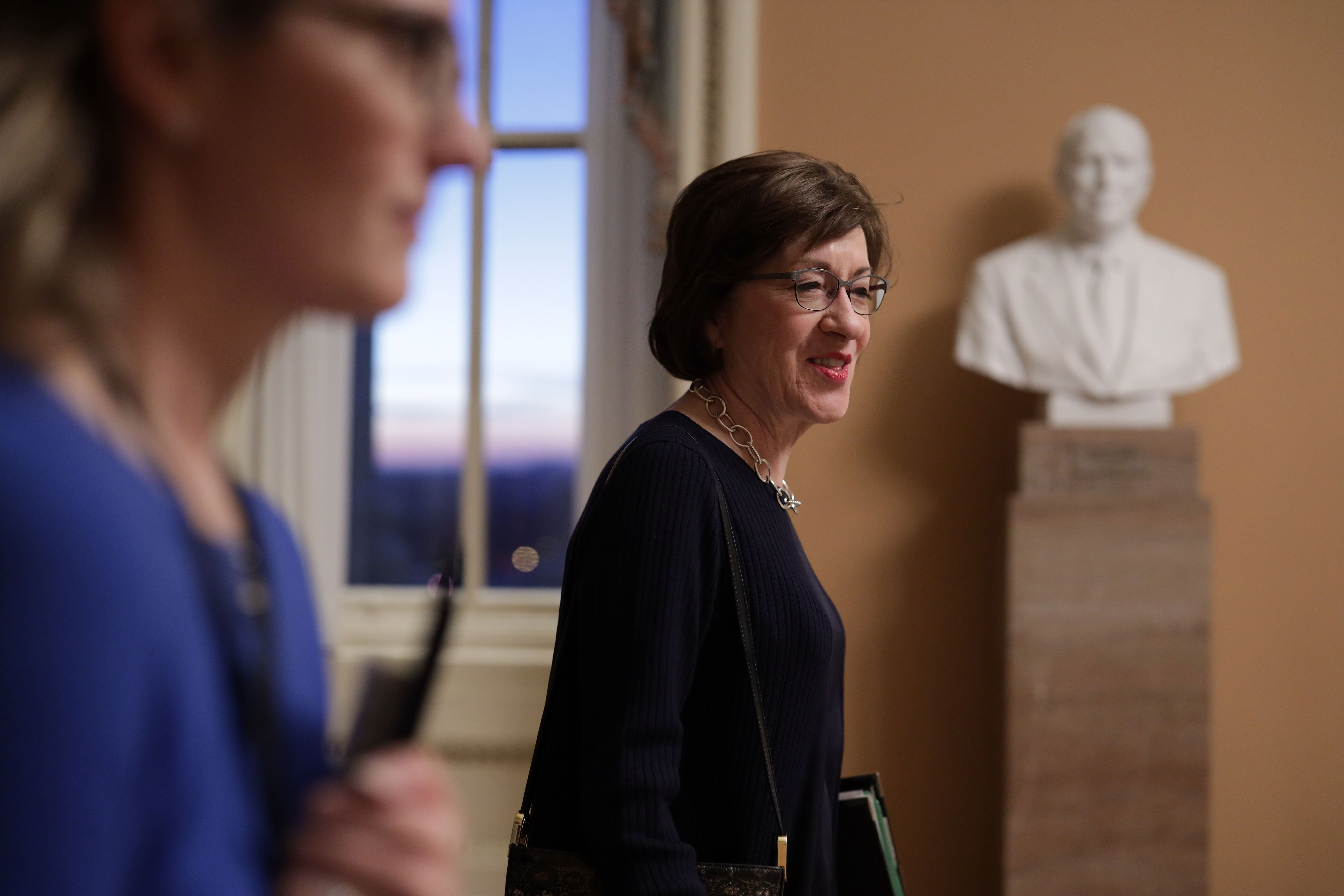 U.S. Sen. Susan Collins (R-ME) (R) walks in a hallway with aides at the U.S. Capitol January 28, 2019 in Washington, DC. (Alex Wong/Getty Images)