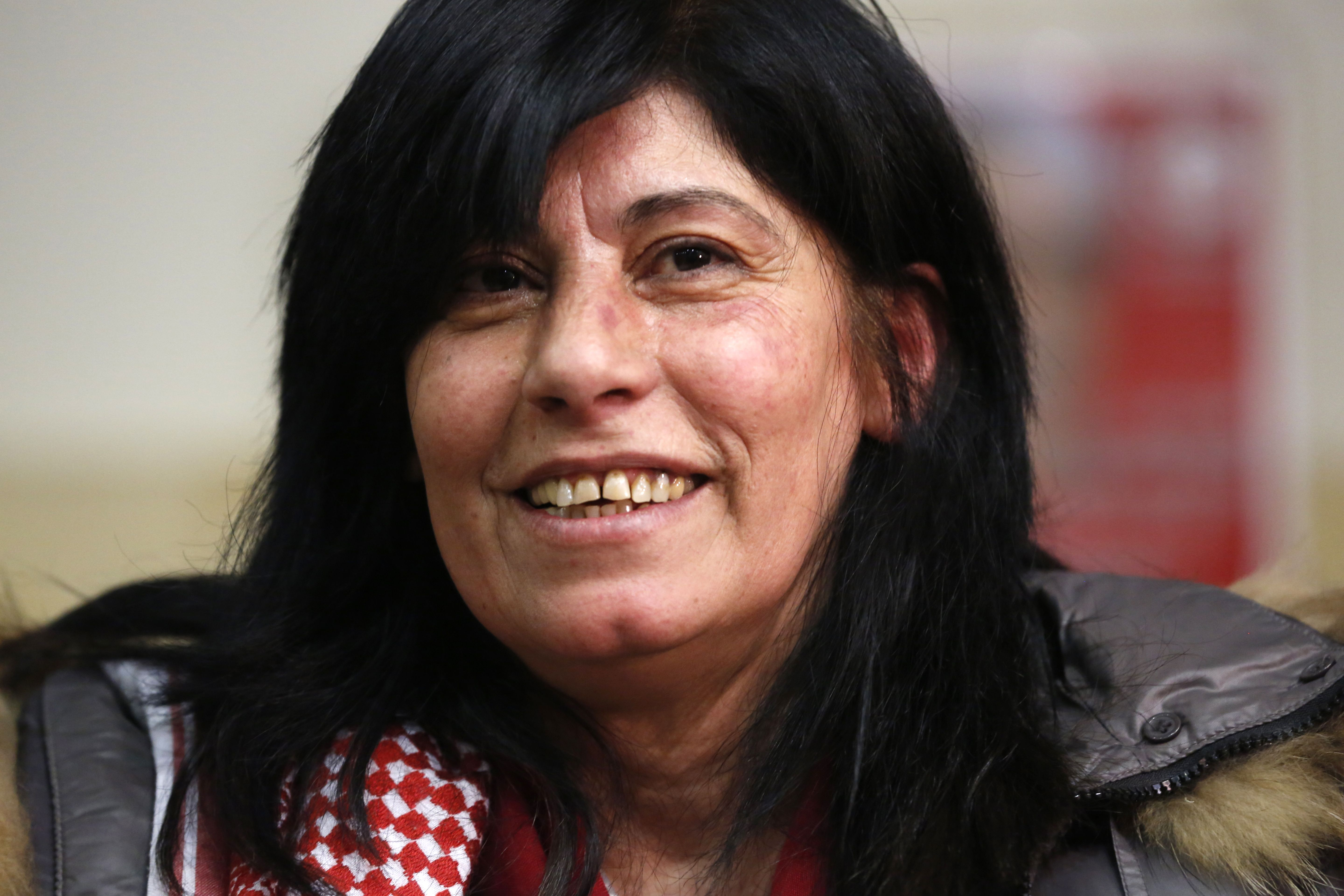 Popular Front for the Liberation of Palestine (PFLP) member Khalida Jarrar, 56, smiles following her release from an Israeli jail, in the occupied West Bank city of Ramallah, on February 28, 2019. (ABBAS MOMANI/AFP/Getty Images)