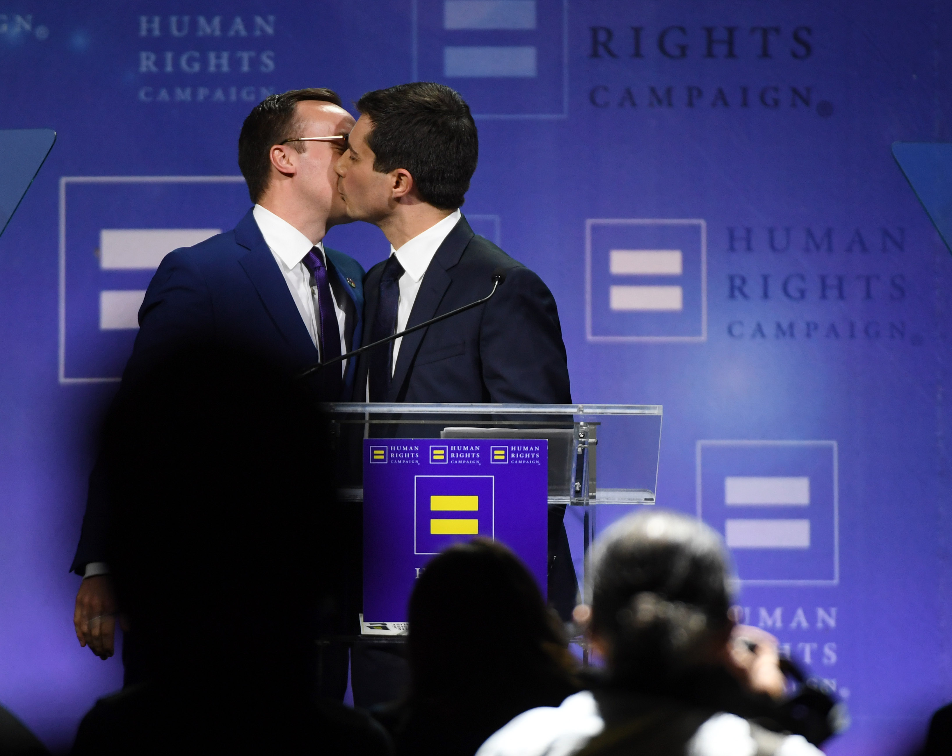 LAS VEGAS, NEVADA - MAY 11: Chasten Glezman Buttigieg (L) kisses his husband, South Bend, Indiana Mayor Pete Buttigieg, after he delivered a keynote address at the Human Rights Campaign's (HRC) 14th annual Las Vegas Gala at Caesars Palace on May 11, 2019 in Las Vegas, Nevada. Buttigieg is the first openly gay candidate to run for the Democratic presidential nomination. The HRC is the largest LGBTQ advocacy group in the United States. (Photo by Ethan Miller/Getty Images)