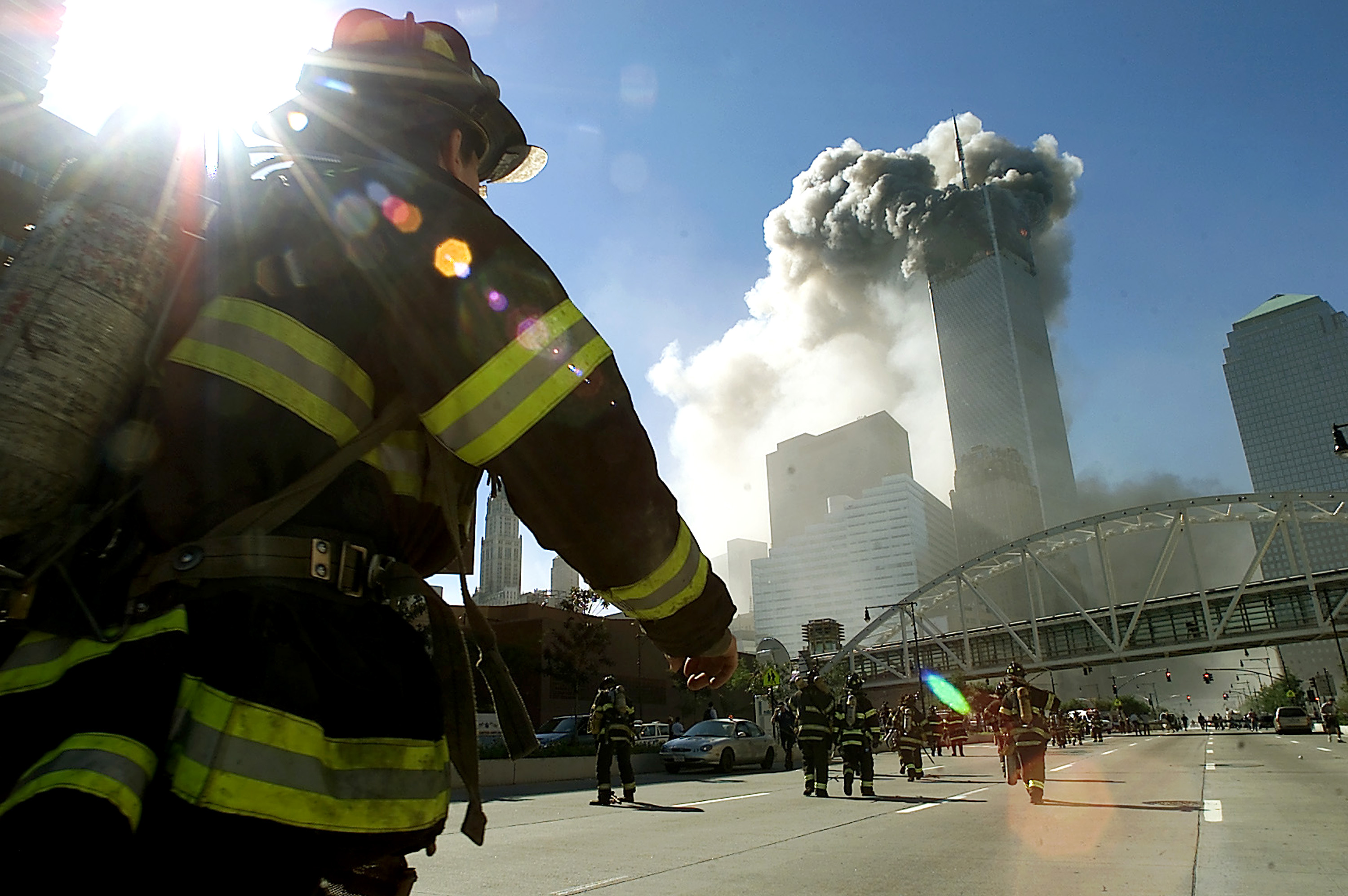 Firefighters walk towards one of the towers at the World Trade Center before it collapsed after a plane hit the building September 11, 2001 in New York City. (Photo by Jose Jimenez/Primera Hora/Getty Images)