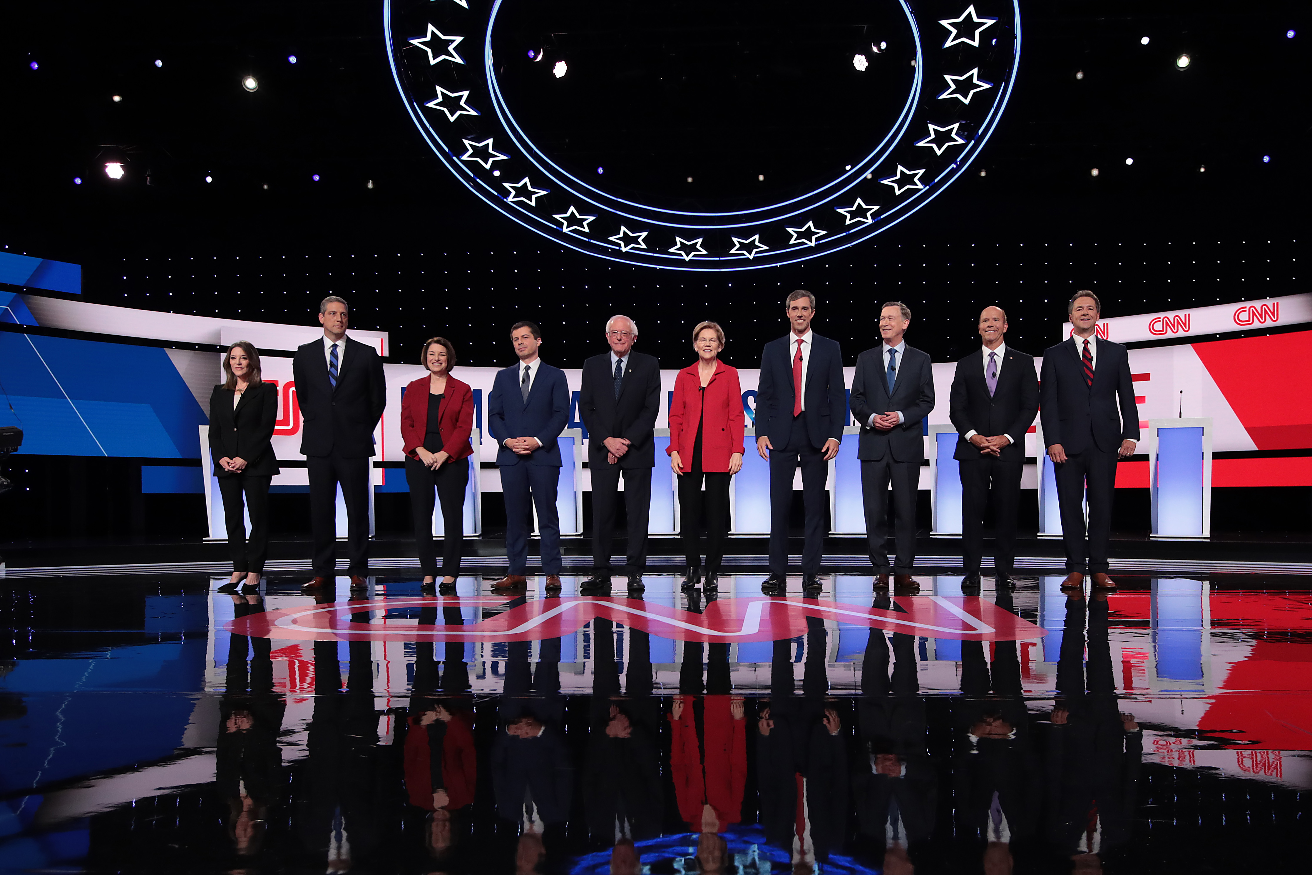 Democratic presidential candidates Marianne Williamson, (L-R), Rep. Tim Ryan (D-OH), Sen. Amy Klobuchar (D-MN), Indiana Mayor Pete Buttigieg, Sen. Bernie Sanders (I-VT), Sen. Elizabeth Warren (D-MA), former Texas congressman Beto O'Rourke, former Colorado governor John Hickenlooper, former Maryland congressman John Delaney, and Montana Gov. Steve Bullock take the stage at the beginning of the Democratic Presidential Debate at the Fox Theatre July 30, 2019. (Scott Olson/Getty Images)