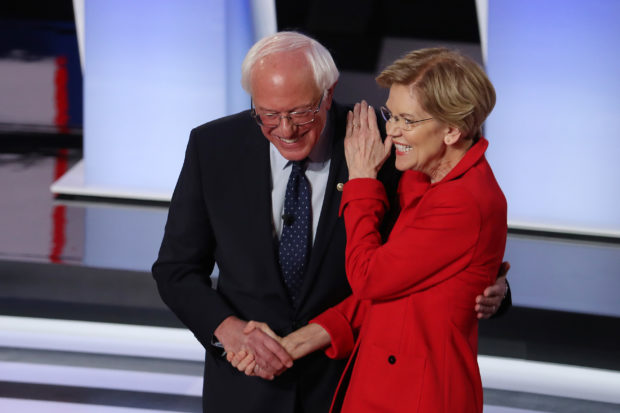 DETROIT, MICHIGAN - JULY 30: Democratic presidential candidate Sen. Bernie Sanders (I-VT) (R) and Sen. Elizabeth Warren (D-MA) greet each other at the start of the Democratic Presidential Debate at the Fox Theatre July 30, 2019 in Detroit, Michigan. 20 Democratic presidential candidates were split into two groups of 10 to take part in the debate sponsored by CNN held over two nights at Detroit's Fox Theatre. (Photo by Justin Sullivan/Getty Images)