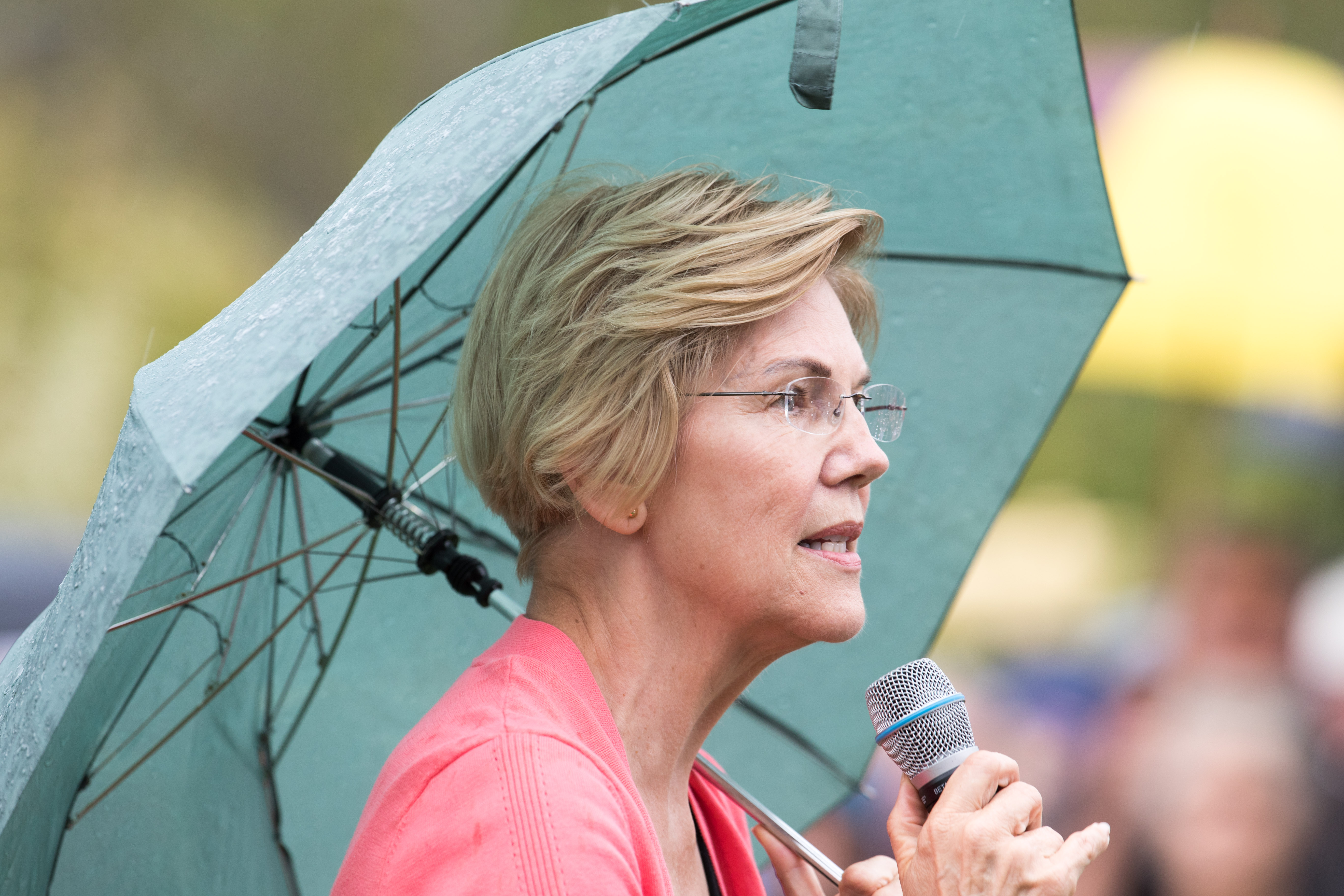 Senator and Democratic presidential candidate Elizabeth Warren speaks to a crowd of around 800 as it begins to rain during a Labor Day house party on September 2, 2019 in Hampton Falls, New Hampshire. (Scott Eisen/Getty Images)
