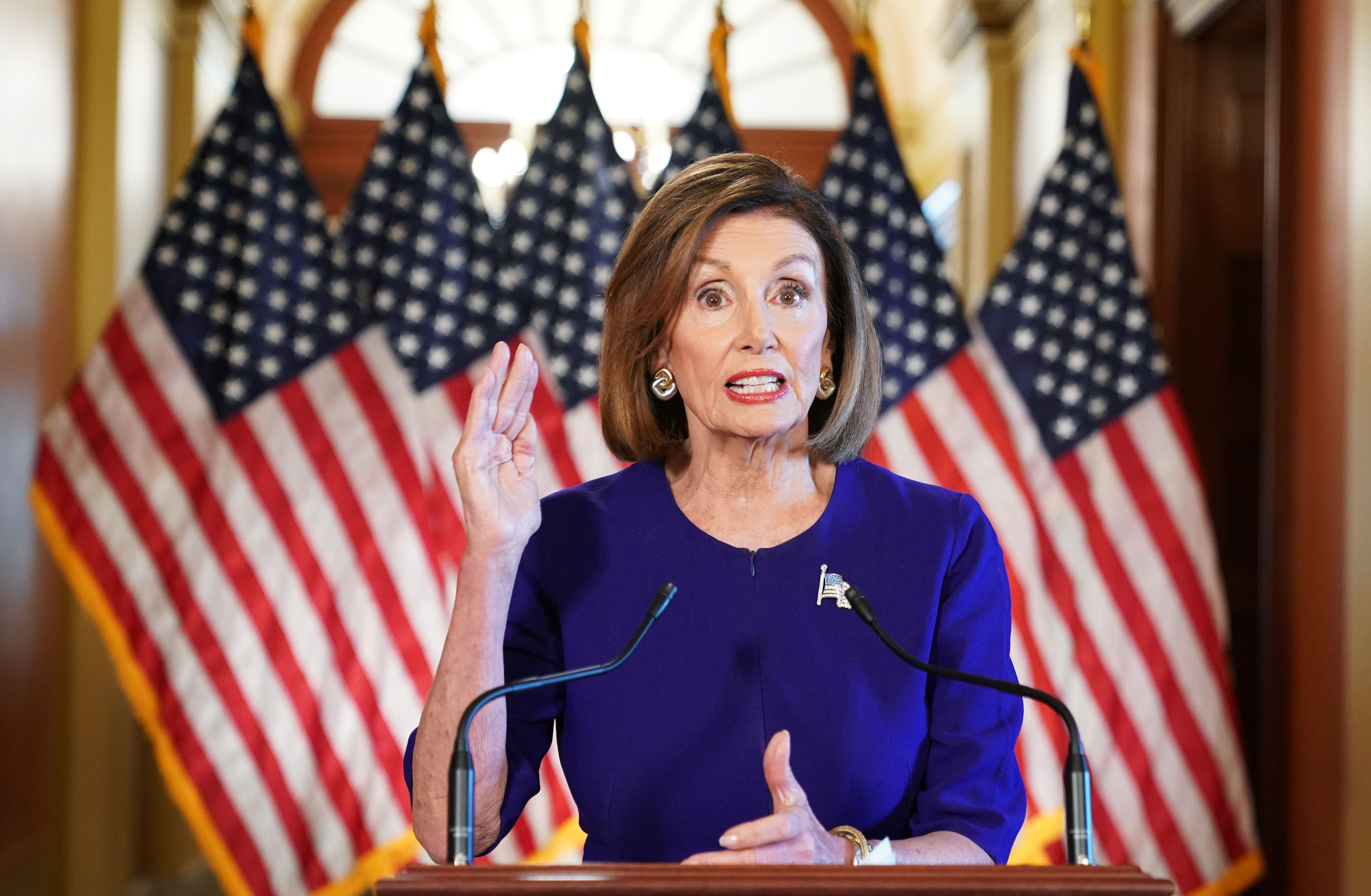 TOPSHOT - US Speaker of the House Nancy Pelosi, Democrat of California, announces a formal impeachment inquiry of US President Donald Trump on September 24, 2019, in Washington, DC. - Amid mounting allegations of abuse of power by the US president, Pelosi announced the start of the inquiry in the House of Representatives, the first step in a process that could ultimately lead to Trump's removal from office. (Photo by MANDEL NGAN / AFP) (Photo by MANDEL NGAN/AFP via Getty Images)