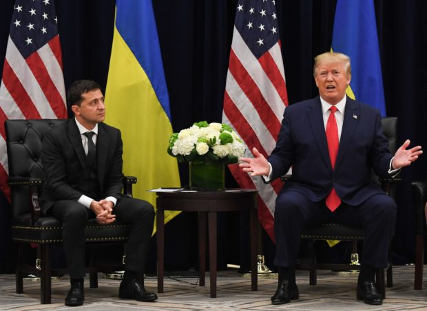 U.S. President Donald Trump speaks as Ukrainian President Volodymyr Zelensky looks on during a meeting in New York on Sept. 25, 2019, on the sidelines of the United Nations General Assembly. (Photo by SAUL LOEB/AFP/Getty Images)