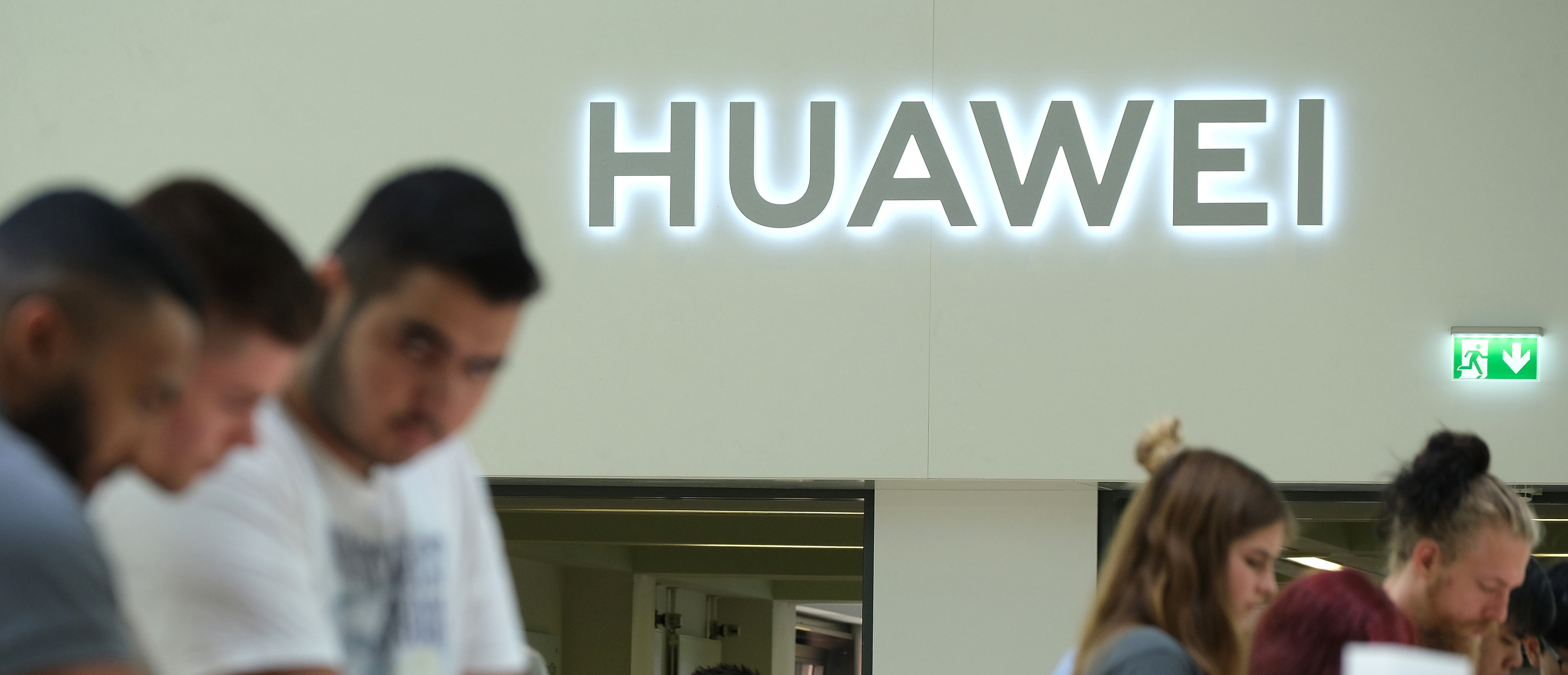 BERLIN, GERMANY - SEPTEMBER 06: Visitors check out new Huawei smartphones at the 2019 IFA home electronics and appliances trade fair on September 06, 2019 in Berlin, Germany. The 2019 IFA fair will be open to the public from September 6-11. (Photo by Sean Gallup/Getty Images)