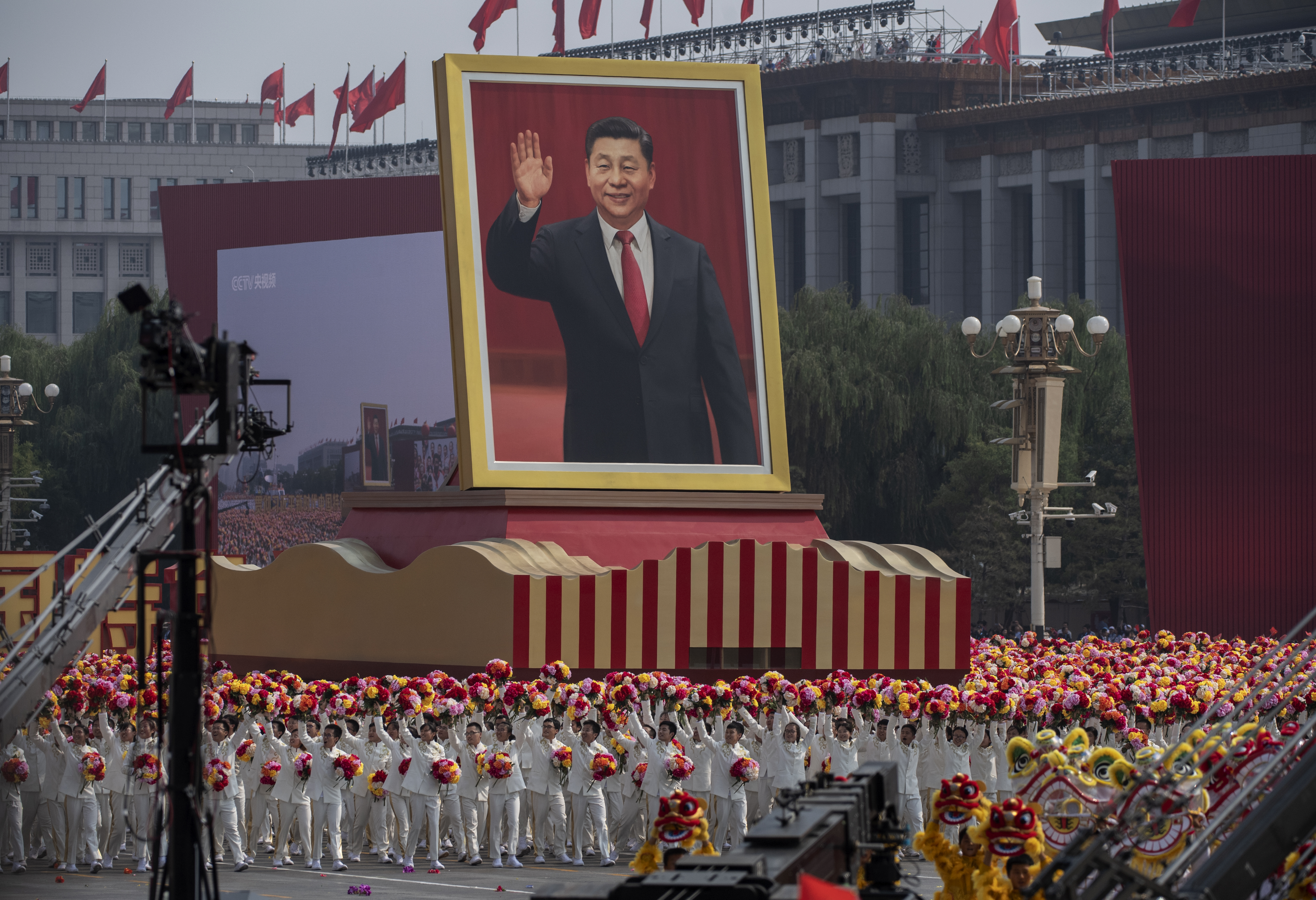 A giant portrait of Chinese President Xi Jinping at Tiananmen Square on October 1, 2019 in Beijing, China. (Photo by Kevin Frayer/Getty Images)