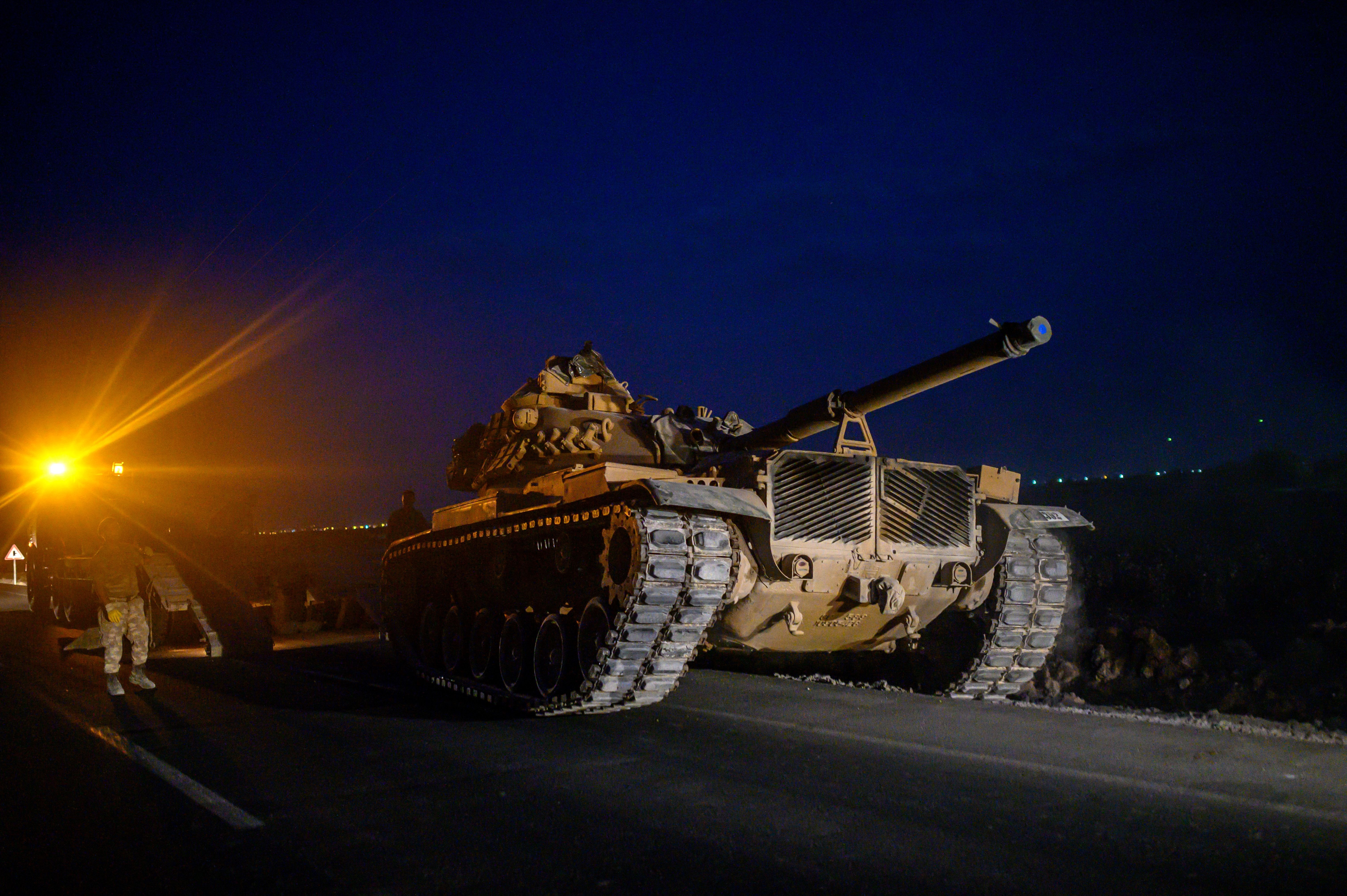 "A Turkish army's tank drives towards the border with Syria near Akcakale in Sanliurfa province on October 8, 2019. - Turkey said on October 8, 2019, it was ready for an offensive into northern Syria, while President Donald Trump insisted the United States had not abandoned its Kurdish allies who would be targeted in the assault. Trump has blown hot and cold since a surprise announcement two days before that Washington was pulling back 50 to 100 ""special operators"" from Syria's northern frontier. (Photo by BULENT KILIC / AFP) (Photo by BULENT KILIC/AFP via Getty Images)"