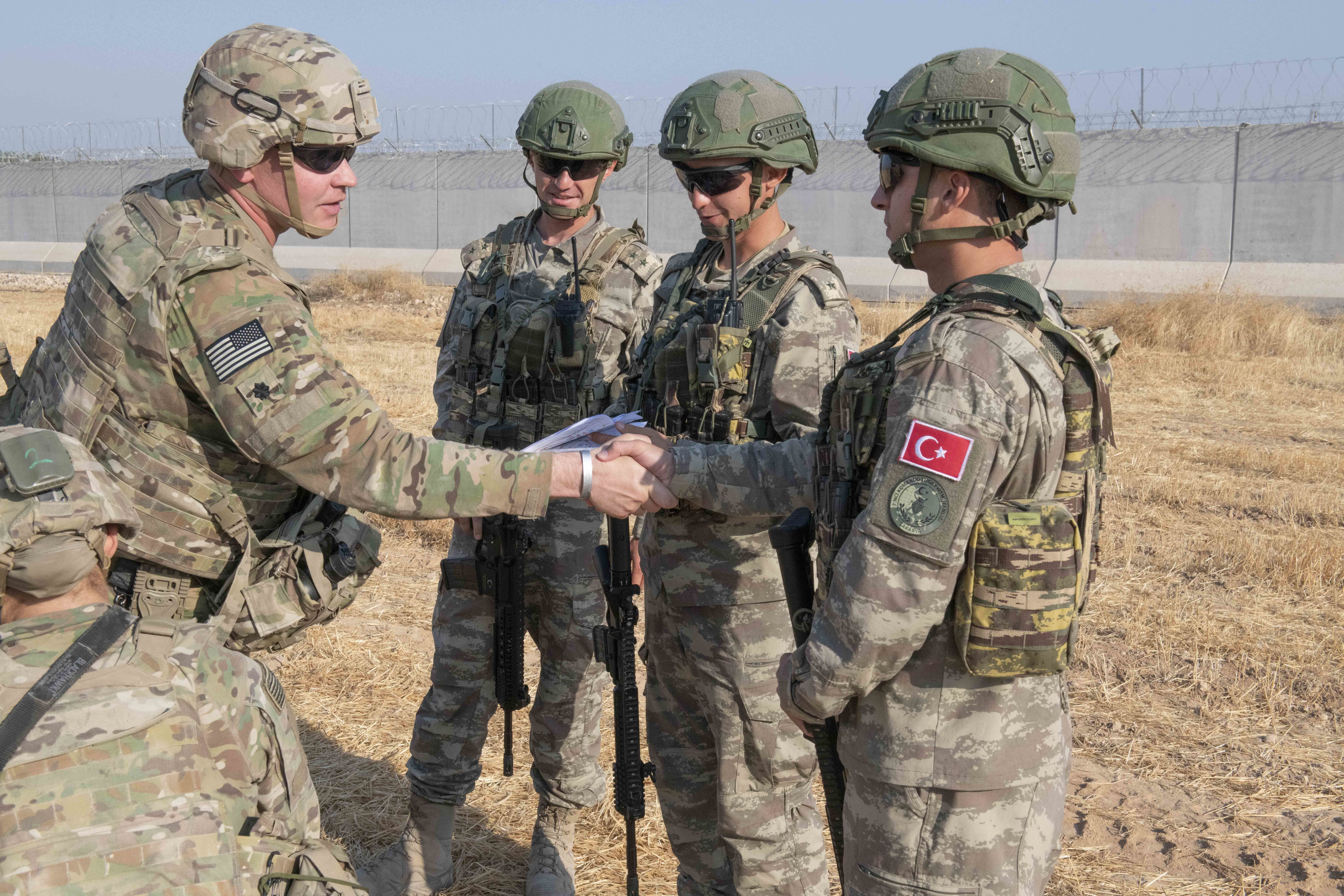 NORTHEAST, SYRIA - OCTOBER 4: In this handout provided by the U.S. Army, U.S. and Turkish military forces conduct the third ground combined joint patrol inside the security mechanism area in northeast Syria, Oct. 4, 2019. The patrol allowed both militaries to observe first-hand progress on destroyed fortification that is a concern for Turkey. The security mechanism is intended to address Turkey's security concerns, maintain security in northeast Syria so Daesh cannot reemerge, and allow the Coalition to remain focused on achieving the enduring defeat of Daesh. The U.S. is currently executing concrete steps to ensure the border area in northeast Syria remains stable and secure. (Photo by Andrew Goedl/U.S. Army via Getty Images)