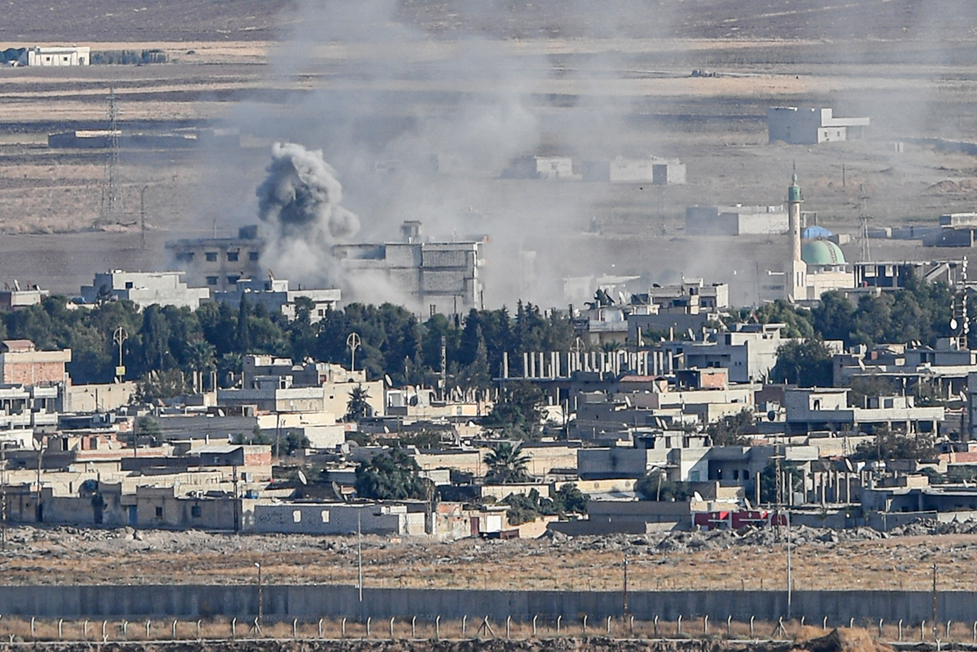 "This picture taken on October 15, 2019 from the Turkish side of the border at Ceylanpinar district in Sanliurfa shows smoke rising from the Syrian town of Ras al-Ain on the first week of Turkey's military operation against Kurdish forces. - The United States is not aware of any ""major"" escape of Islamic State extremists since Turkey launched its assault on Syrian Kurdish fighters holding the prisoners, an official said Tuesday. (Photo by Ozan KOSE / AFP) (Photo by OZAN KOSE/AFP via Getty Images)"