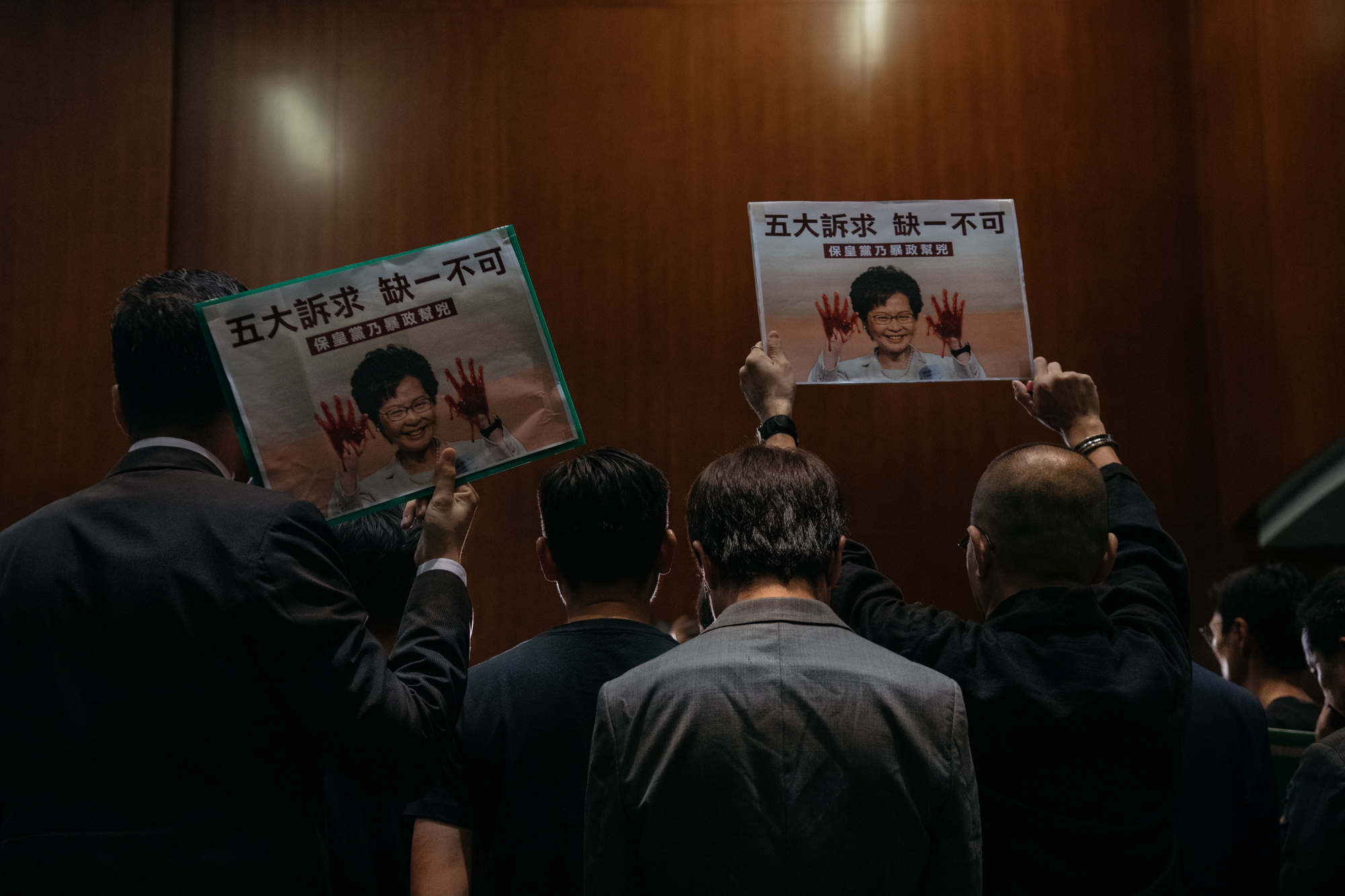 Pan-democratic legislators raise posters during a press conference after Hong Kong Chief Executive Carrie Lam left the Legislative Council on October 16, 2019 in Hong Kong, China. (Photo by Billy H.C. Kwok/Getty Images)