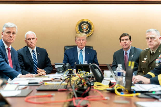 WASHINGTON, DC - OCTOBER 26: In this handout photo provided by the White House, President Donald J. Trump is joined by Vice President Mike Pence (2nd L), National Security Advisor Robert O'Brien (L), Secretary of Defense Mark Esper (2nd R) and Chairman of the Joint Chiefs of Staff U.S. Army General Mark A. Milley in the Situation Room of the White House October 26, 2019 in Washington, DC. The President was monitoring developments as U.S. Special Operations forces close in on ISIS leader Abu Bakr al-Baghdadi's compound in Syria with a mission to kill or capture the terrorist. (Photo by Shealah Craighead/The White House via Getty Images)