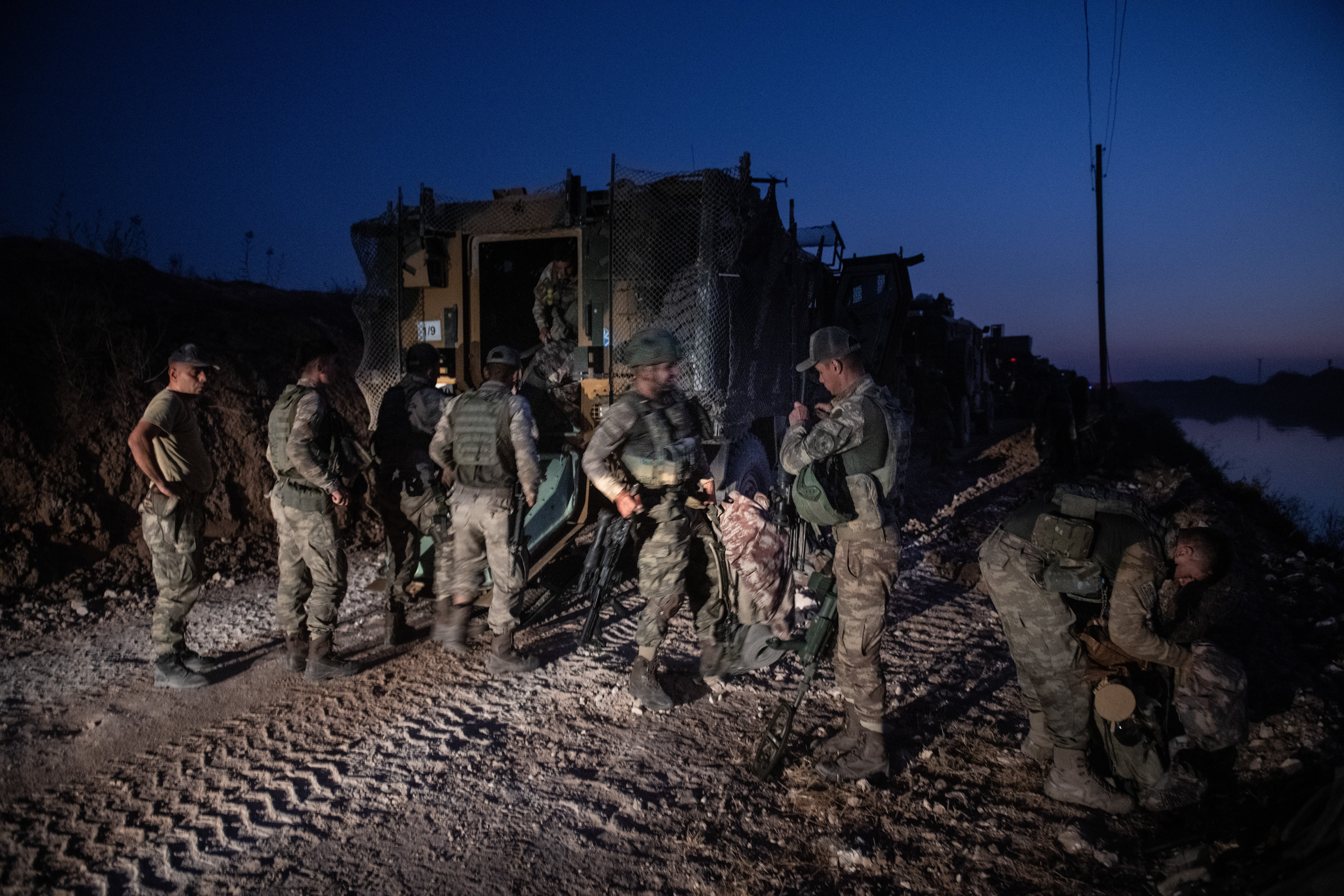 AKCAKALE, TURKEY - OCTOBER 09: First group of Turkish infantry prepare to enter Syria on the border between Turkey and Syria on October 09, 2019 in Akcakale, Turkey. The military action is part of a campaign to extend Turkish control of more of northern Syria, a large swath of which is currently held by Syrian Kurds, whom Turkey regards as a threat. U.S. President Donald Trump granted tacit American approval to this campaign, withdrawing his country's troops from several Syrian outposts near the Turkish border. (Photo by Burak Kara/Getty Images)